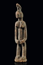 Standing female figure carrying a bird on the head, Mali, Dogon