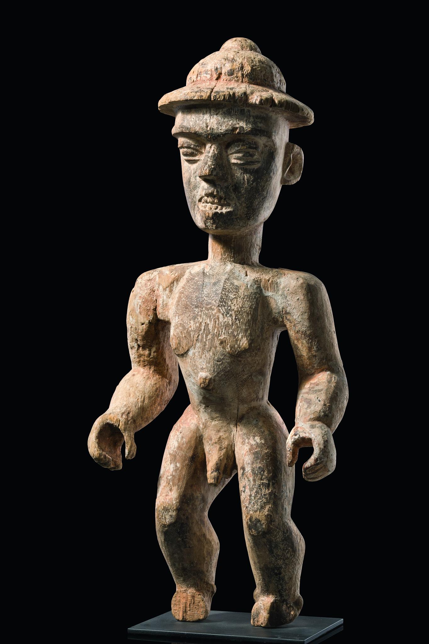 Stehende männliche Figur mit Tropenhelm