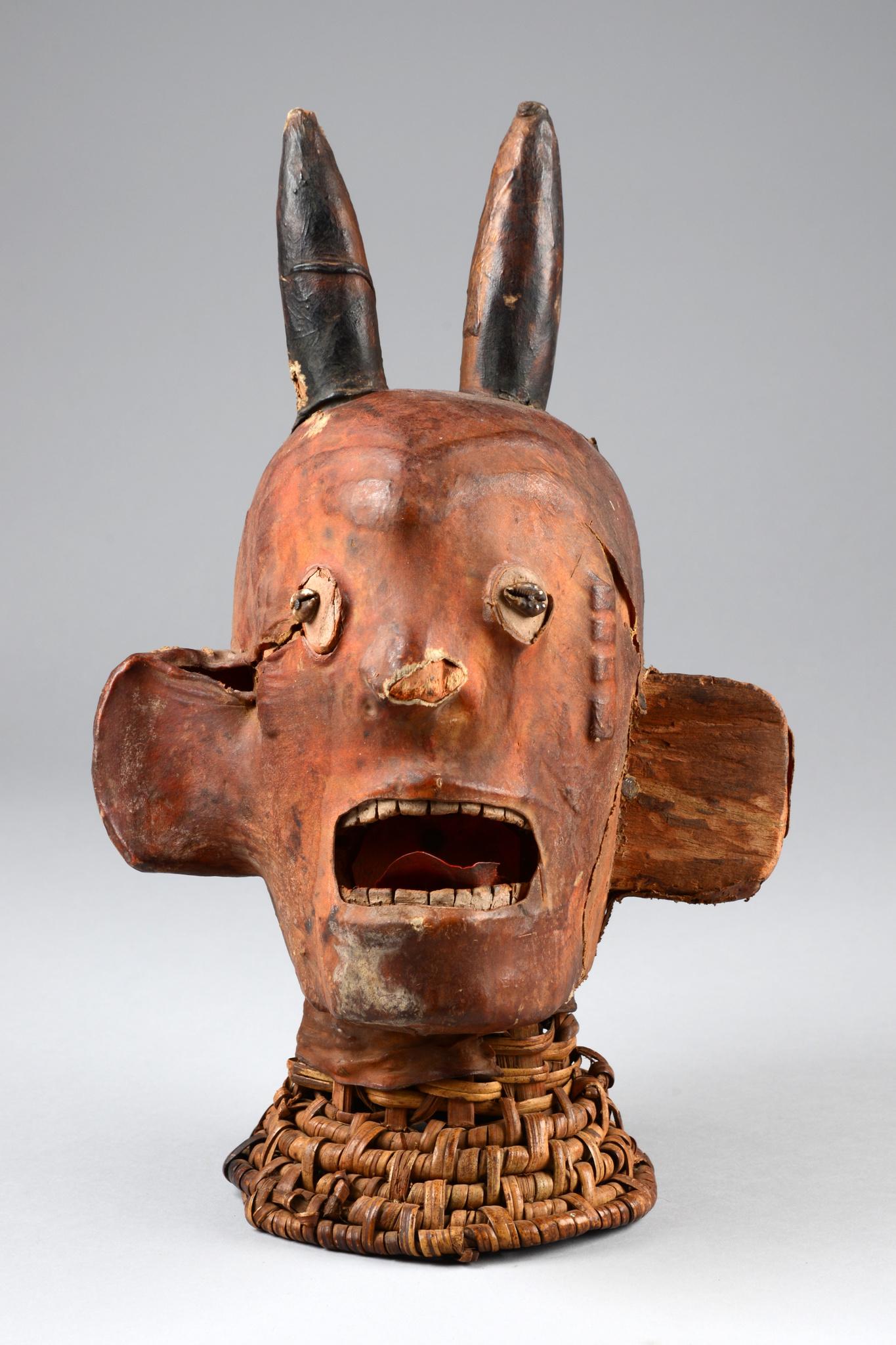 Anthropomorphic headdress with horns