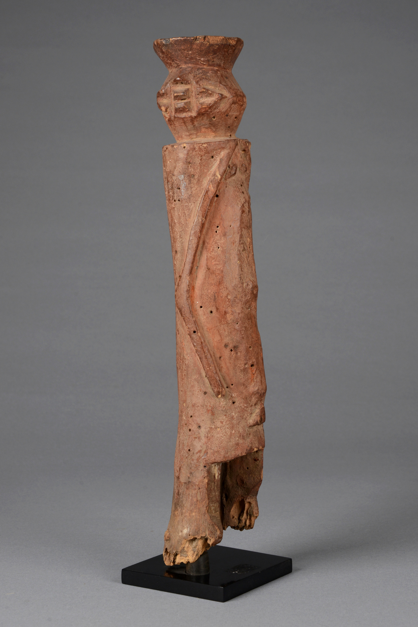 Standing figure with turned head