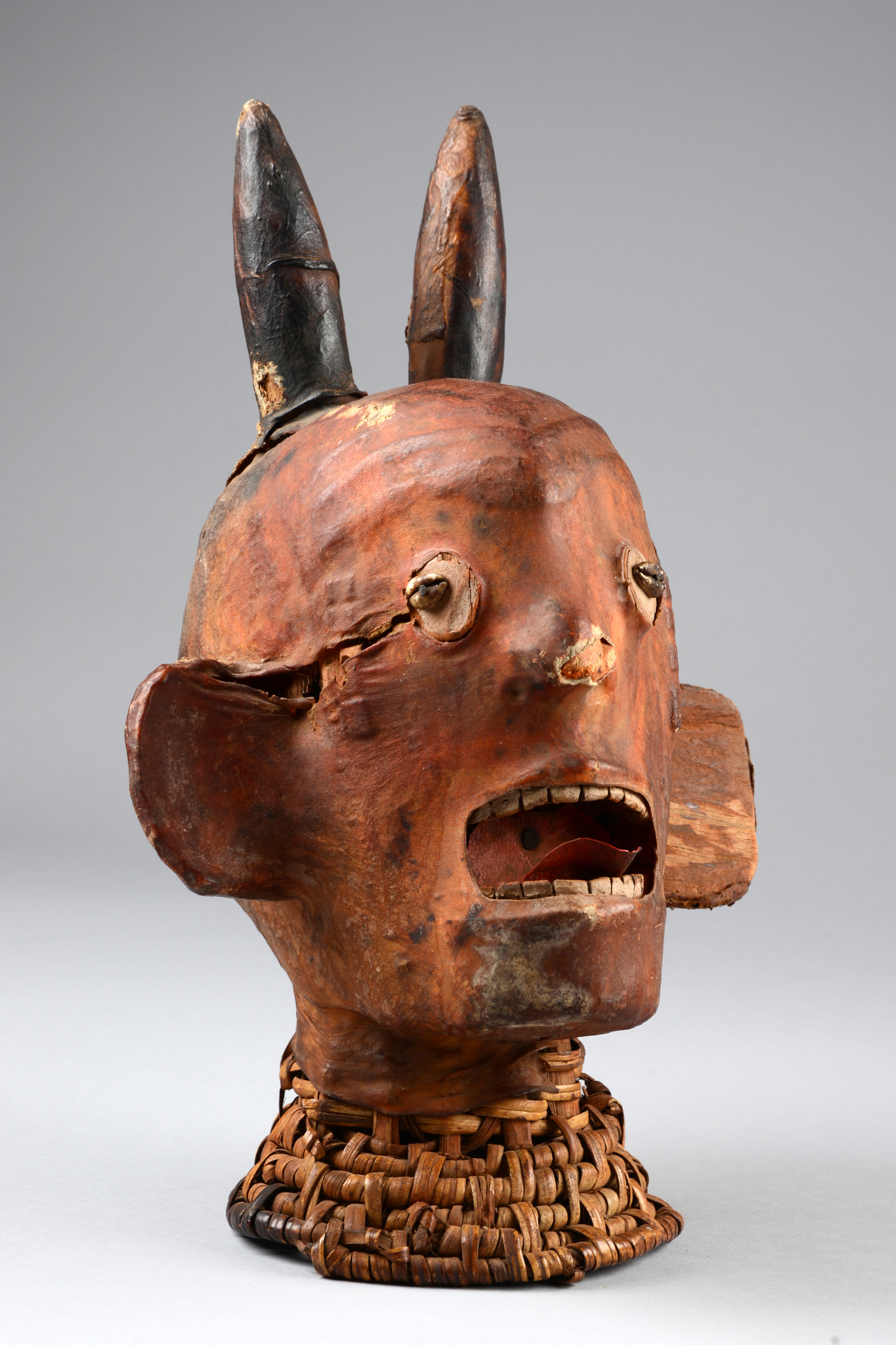 Anthropomorphic headdress with horns