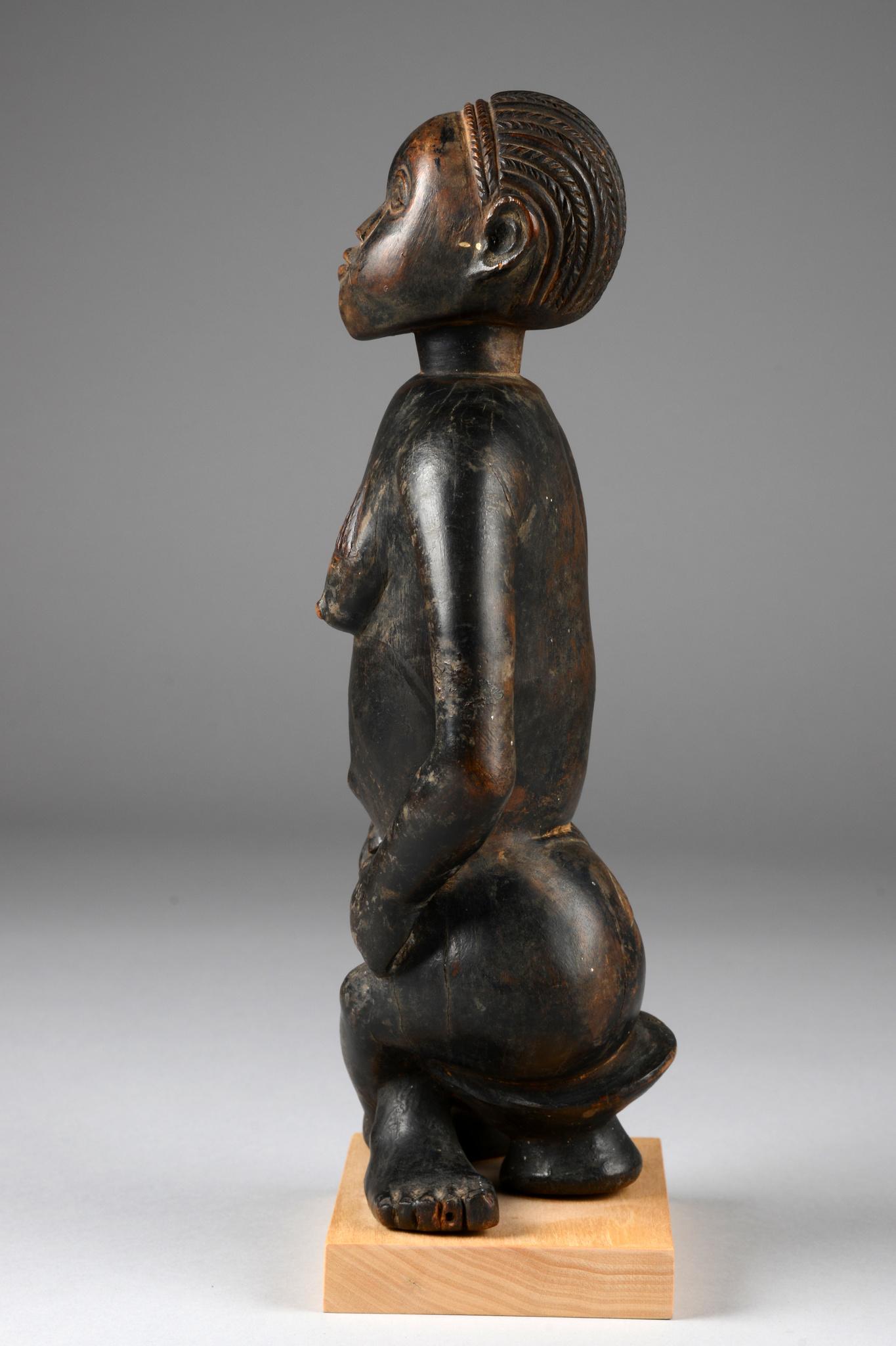 Seated female figure