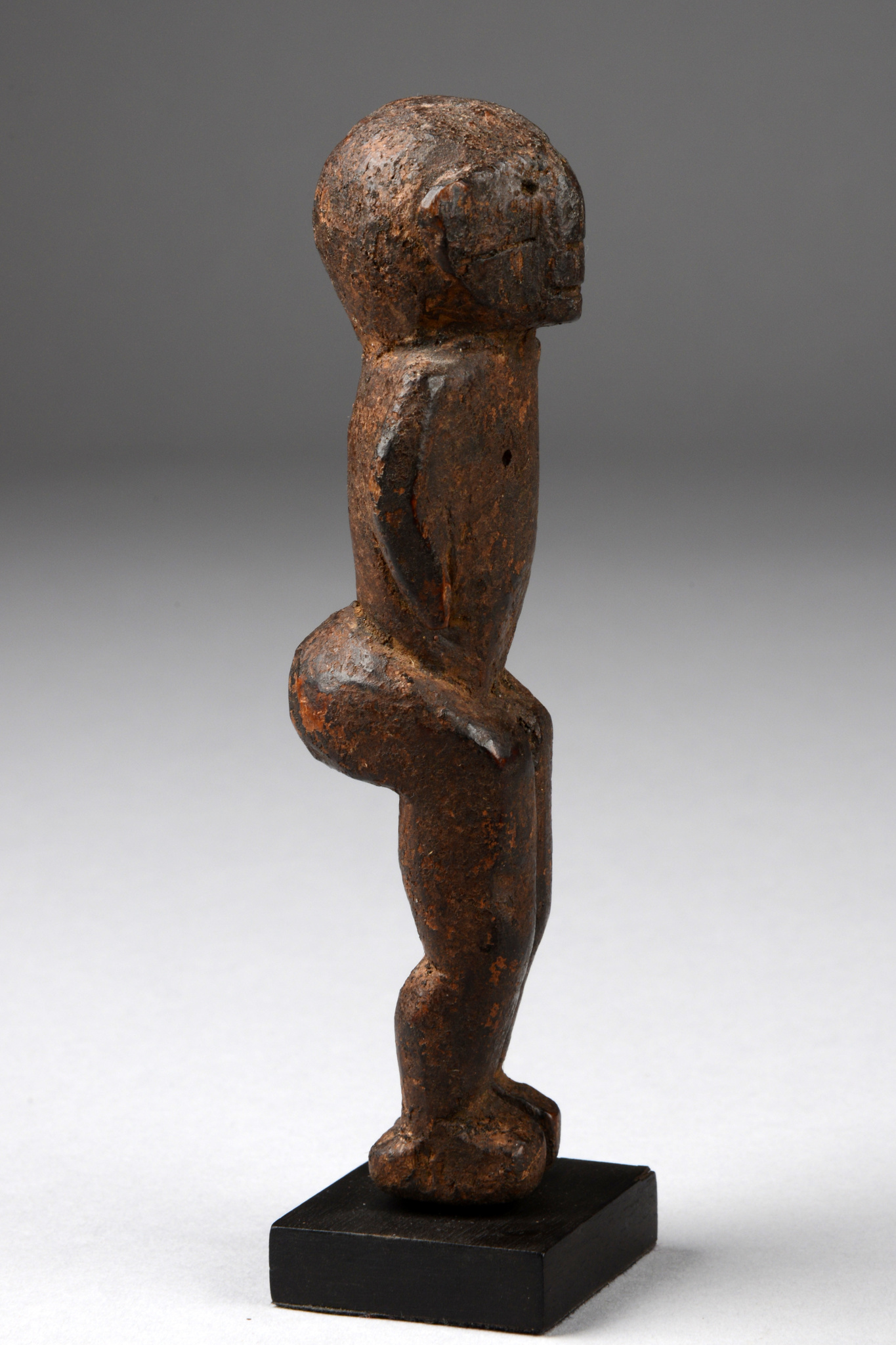 Small standing figure