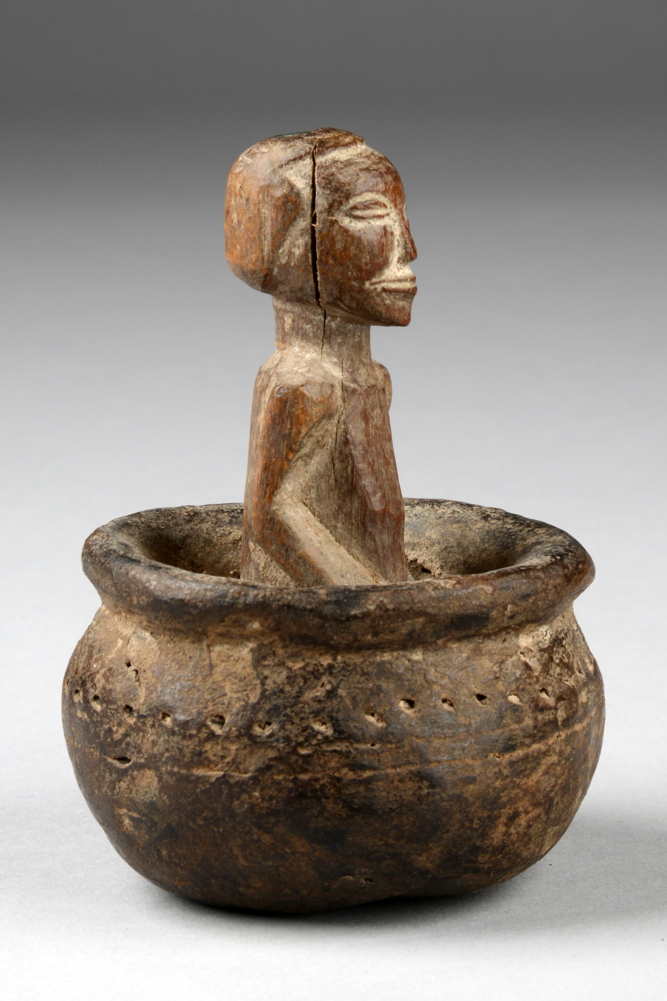 Small pot with power figure