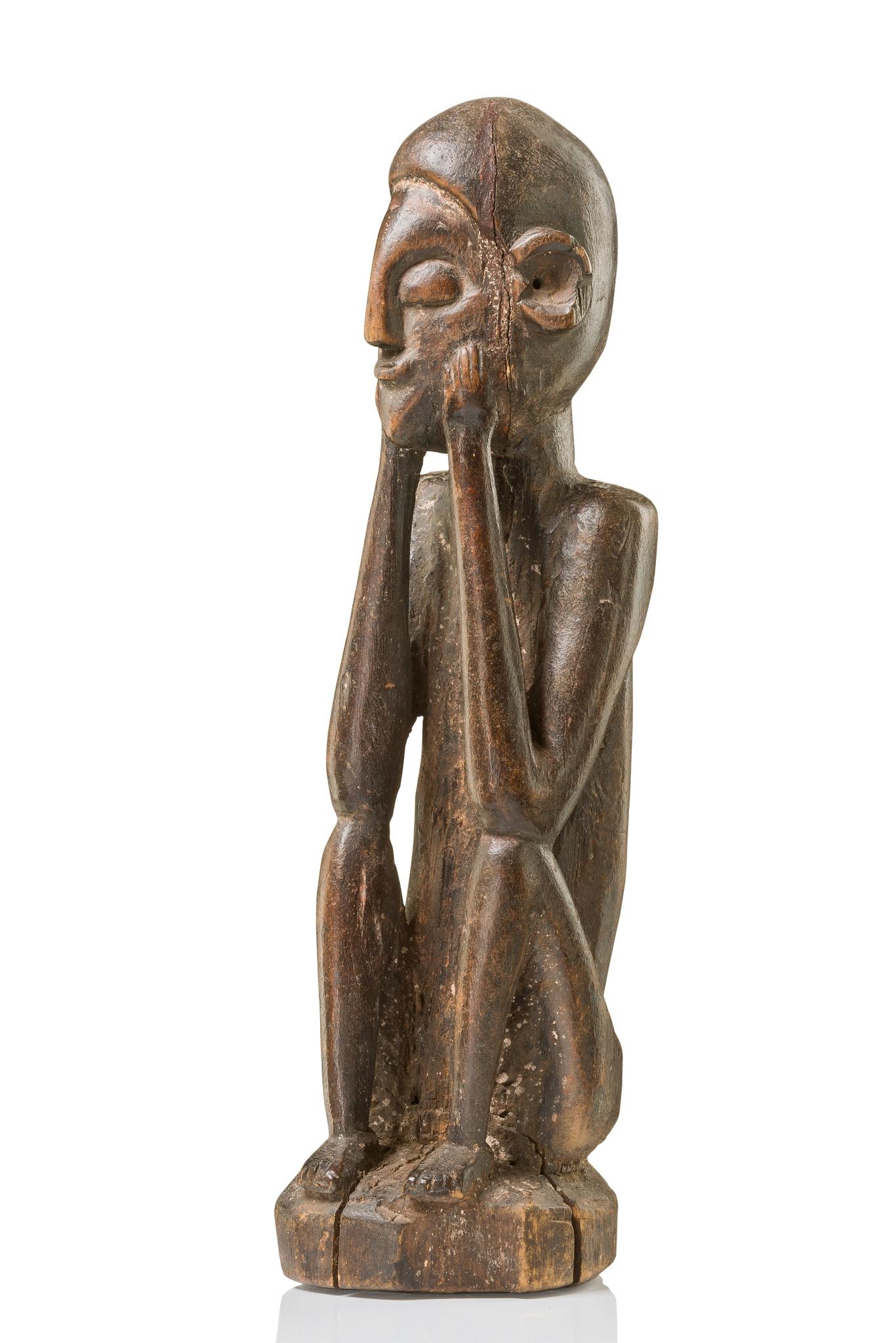 """Squatting figure """"mwunzi"""""""