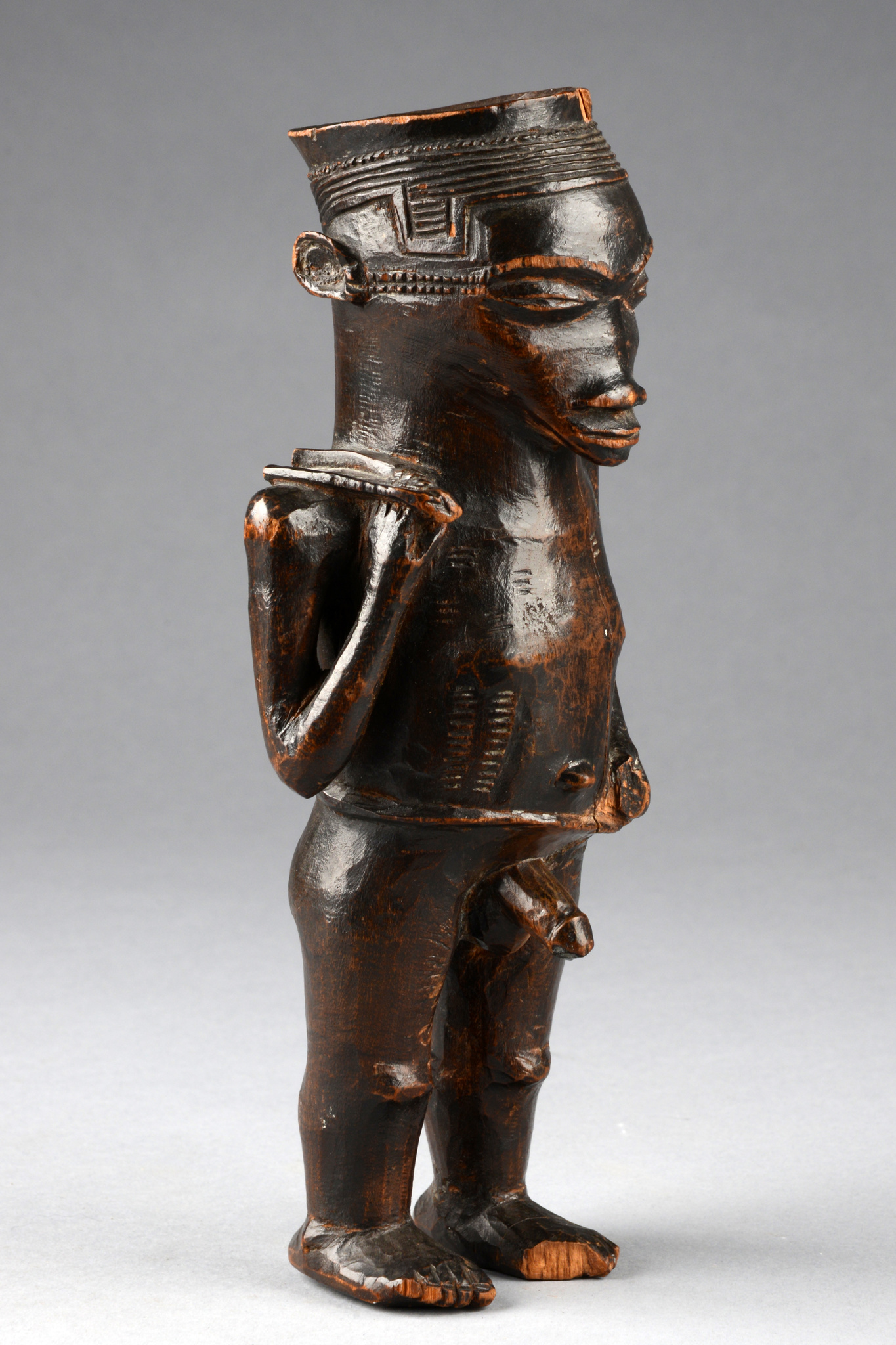 Cup in shape of a standing male figure