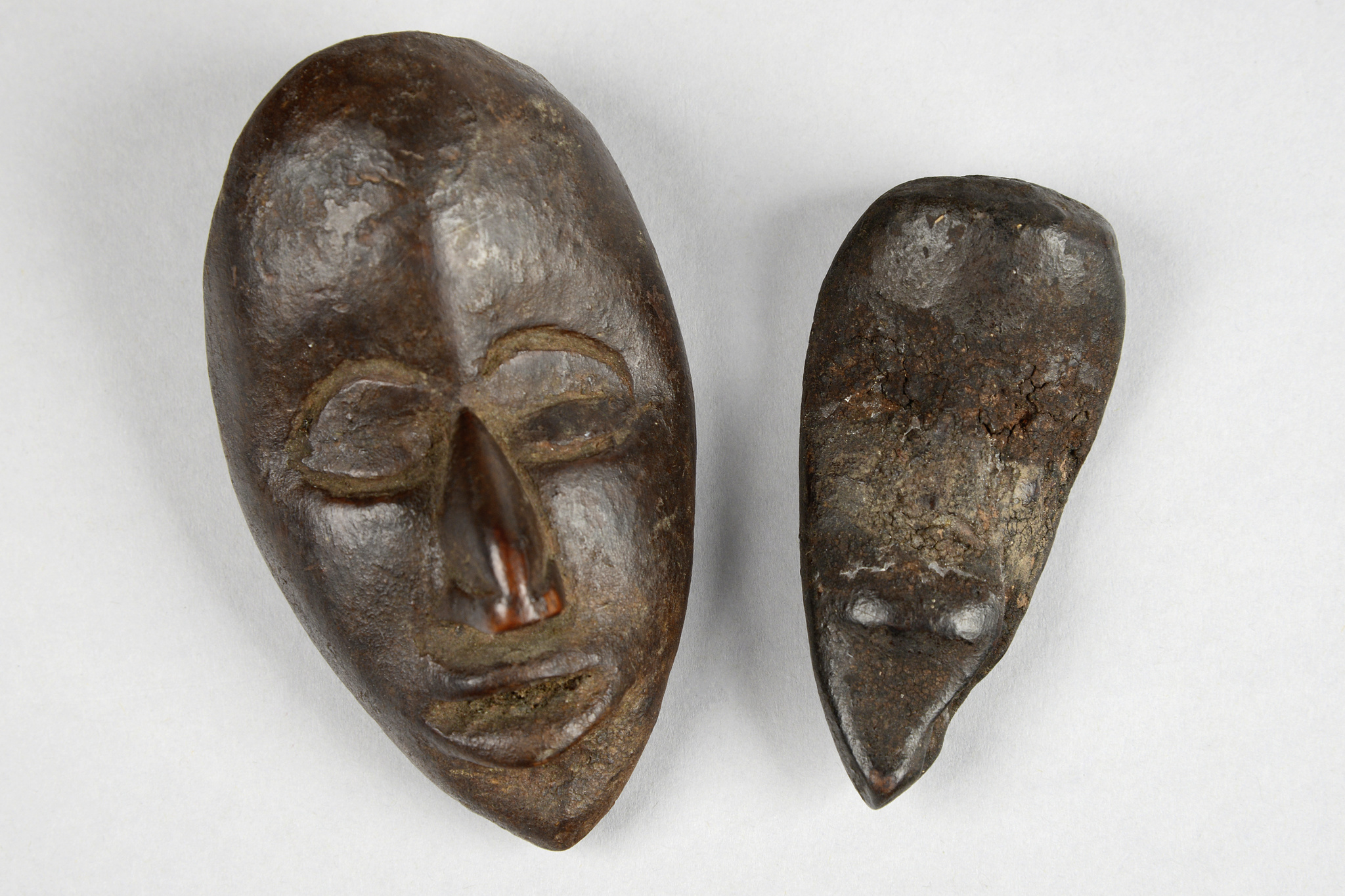 "Two miniature masks ""ma go"""