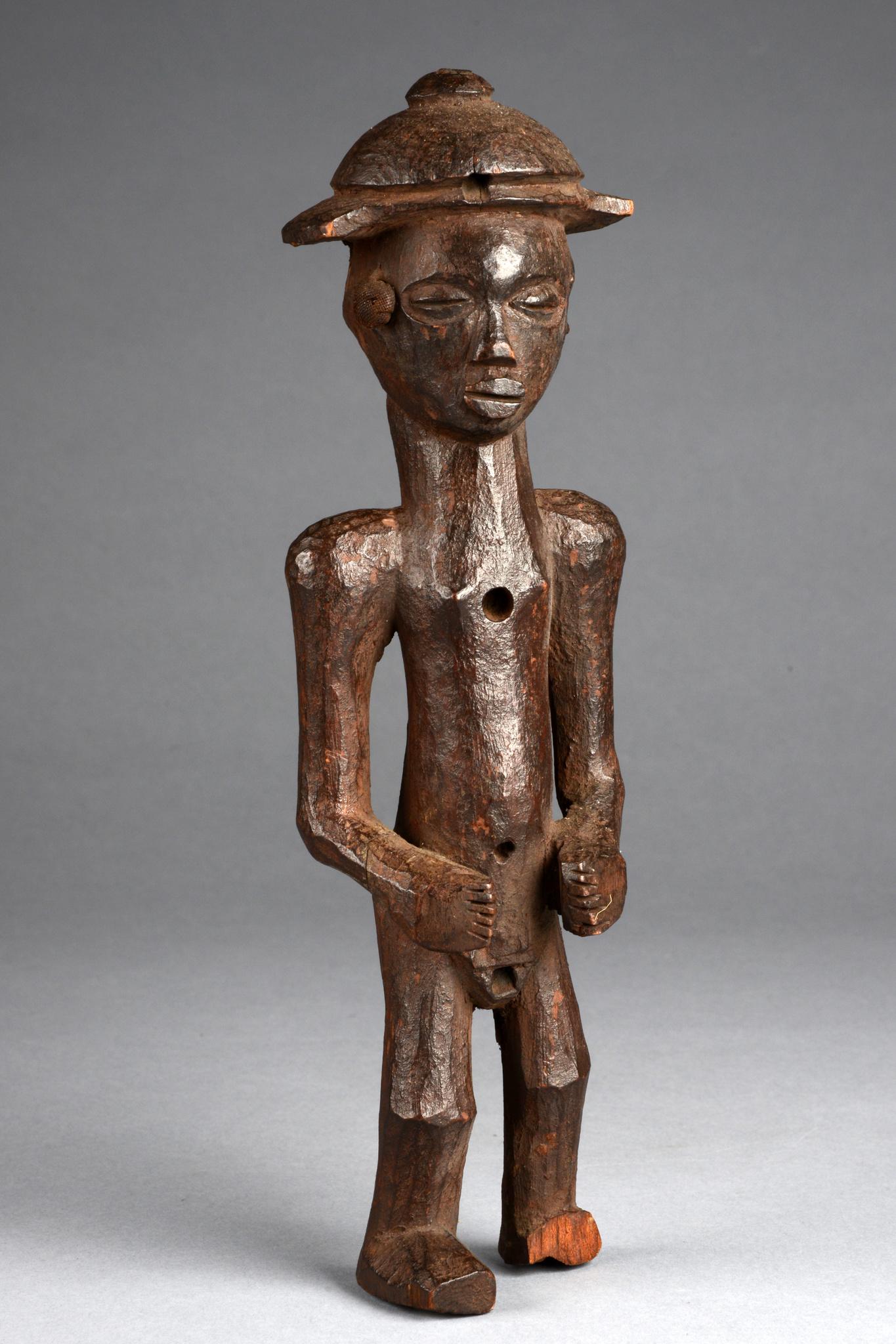 Figure with sun helmet
