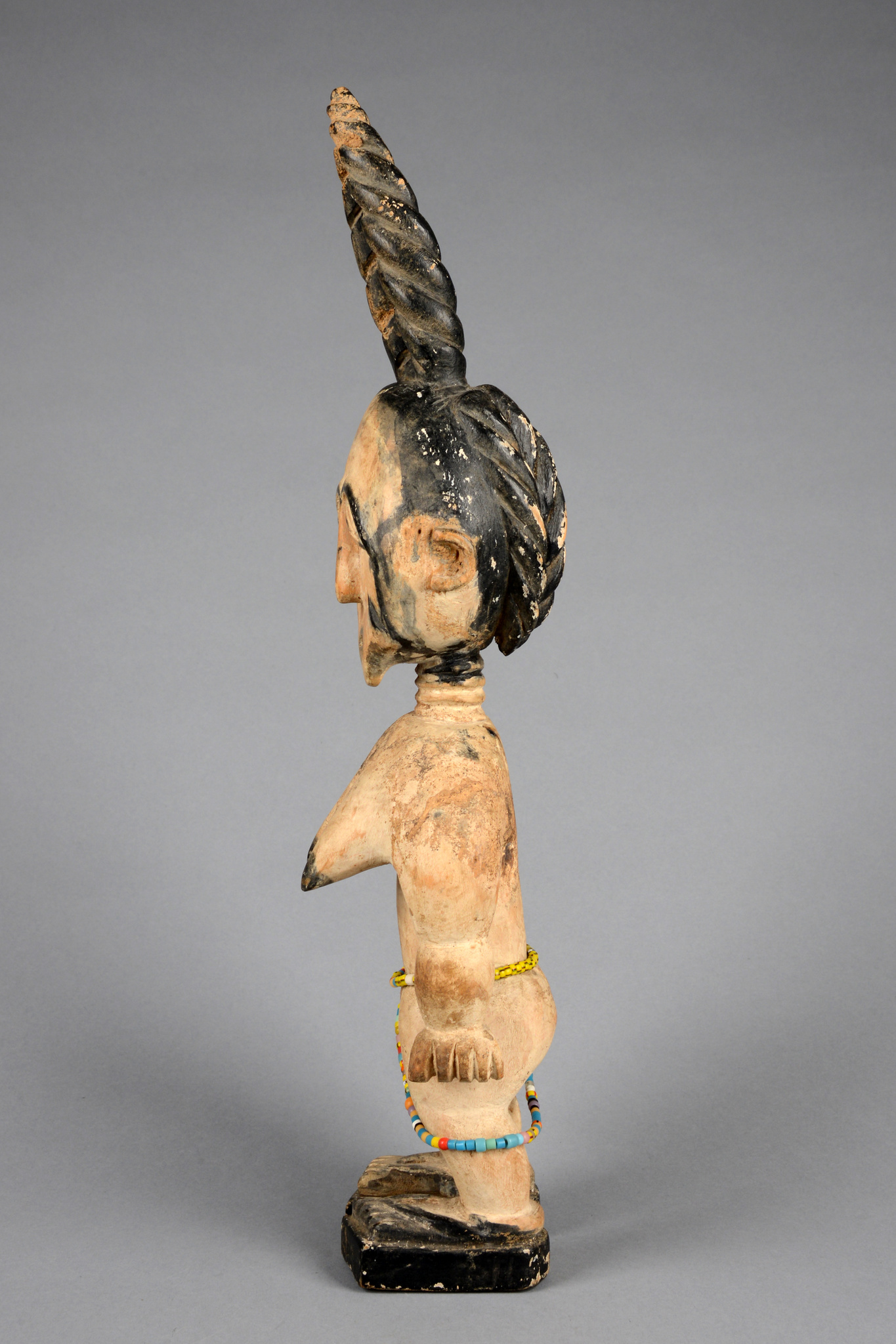 Female figure with horned hairdo