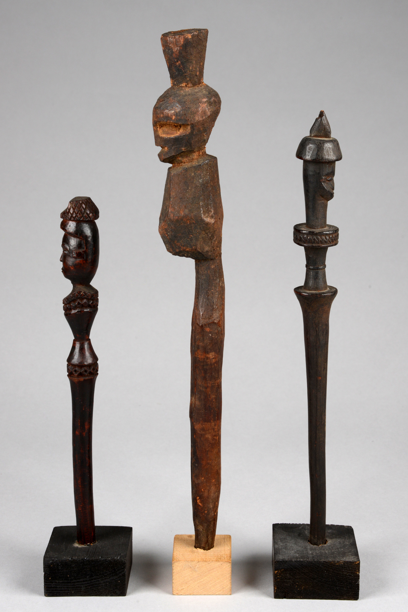 Three calabash stoppers in anthropomorphic shape