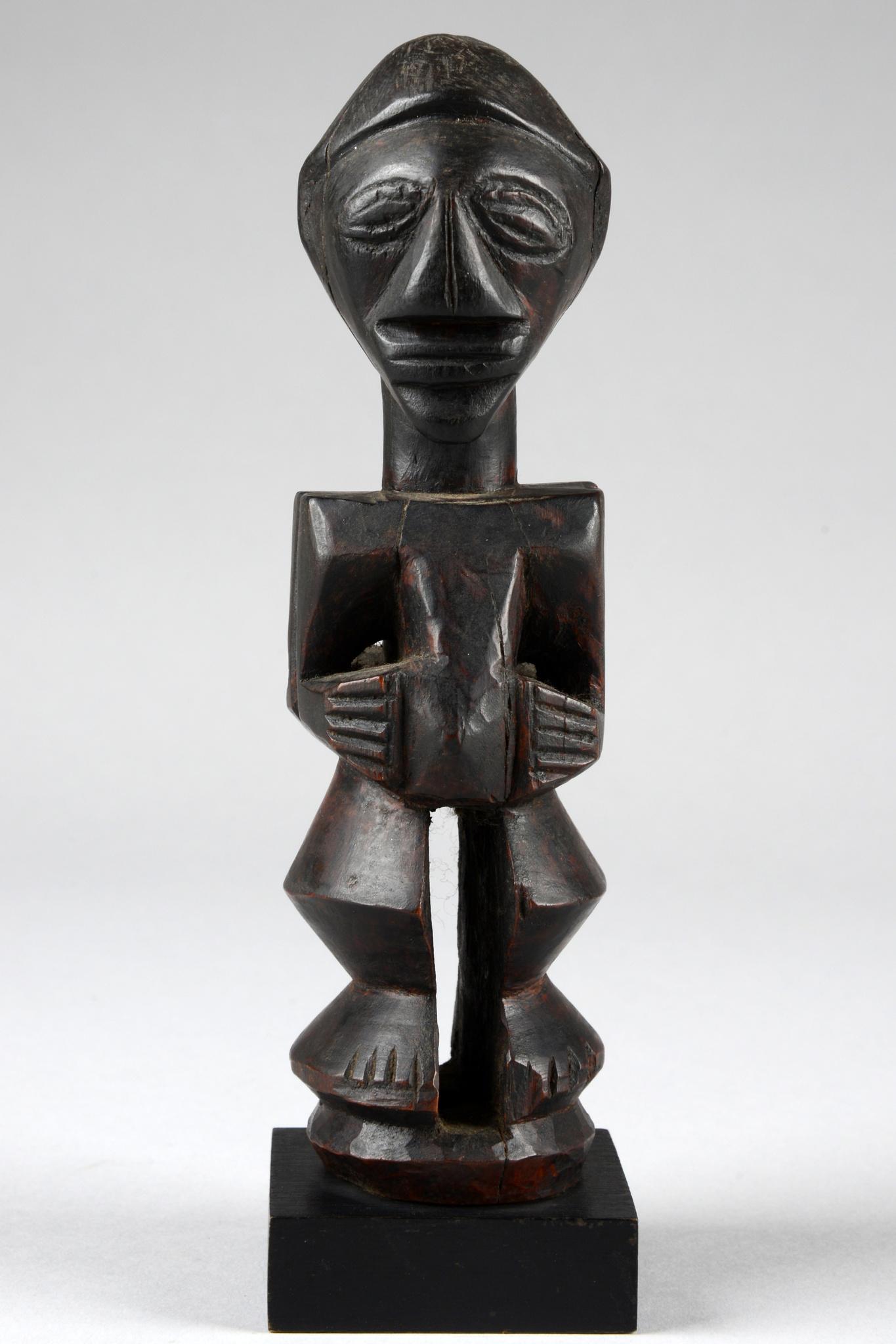 Small standing janus figure