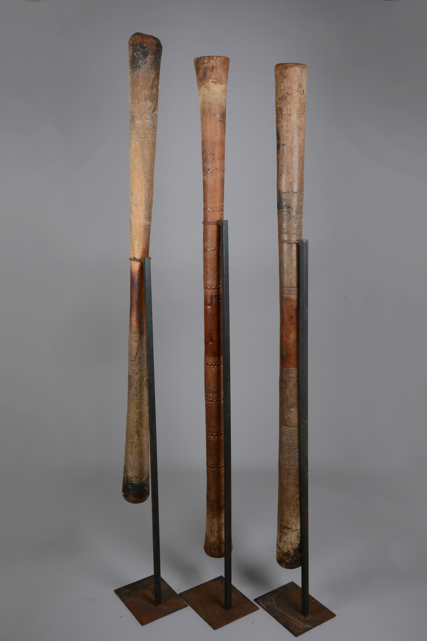 Three old millet pounder