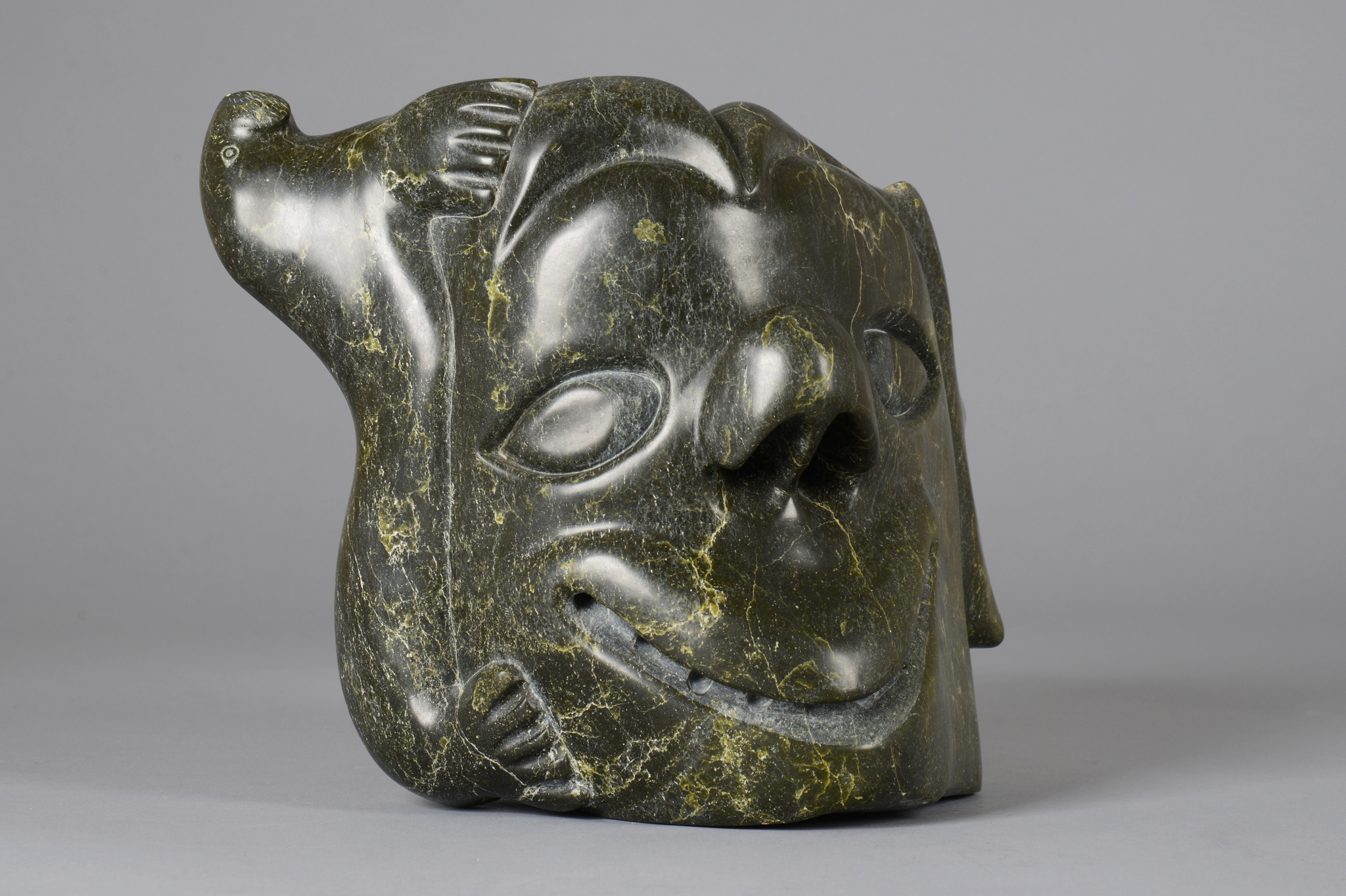 Head sculpture with seal