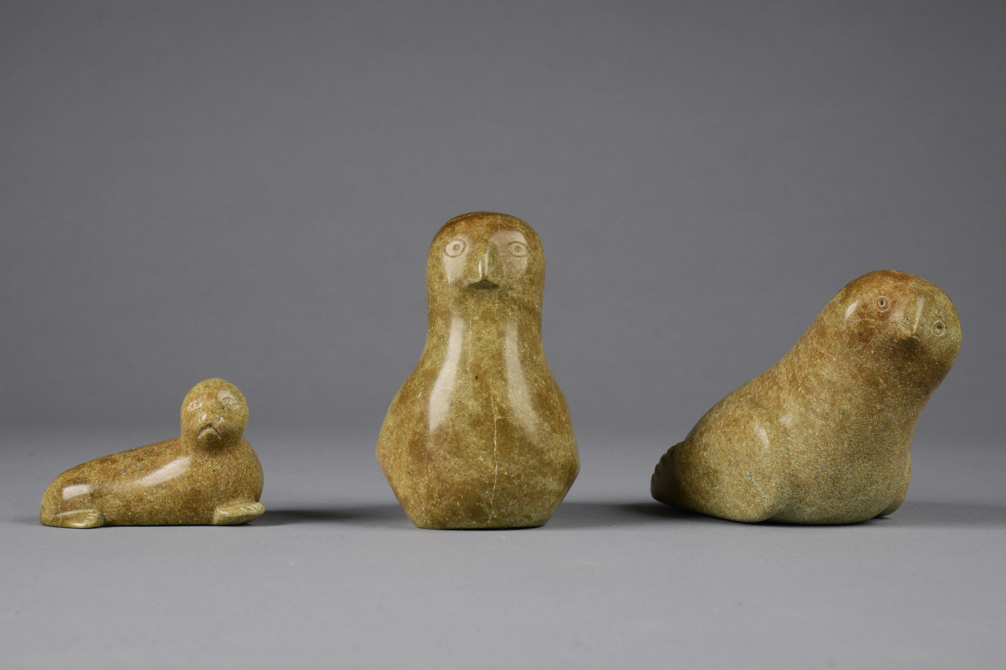 Three stone sculptures (two birds/ seal)