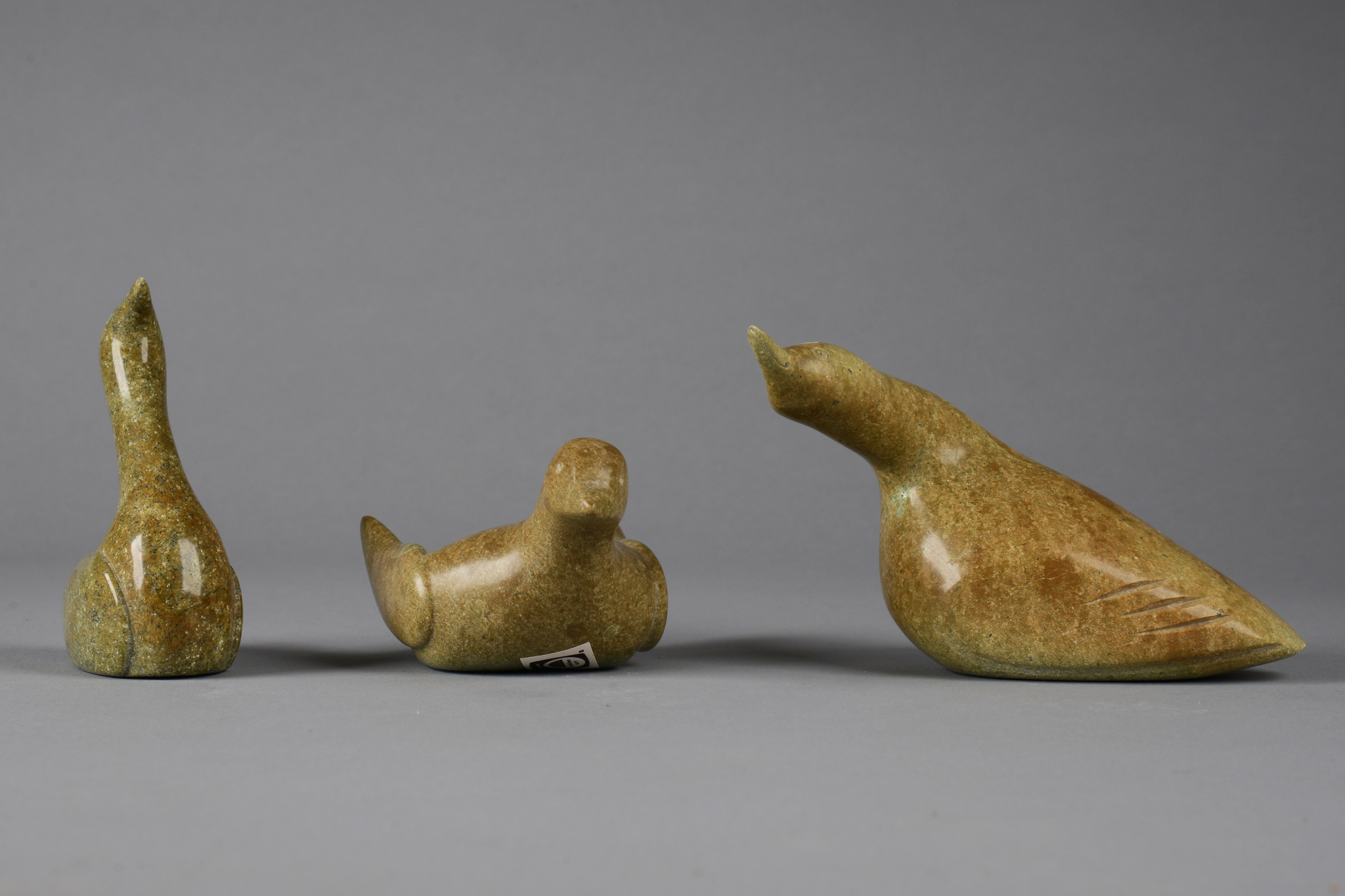 Three stone sculptures (birds)