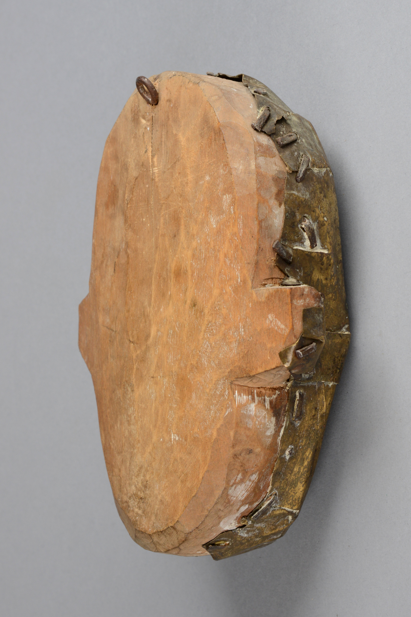 Mask-like head sculpture