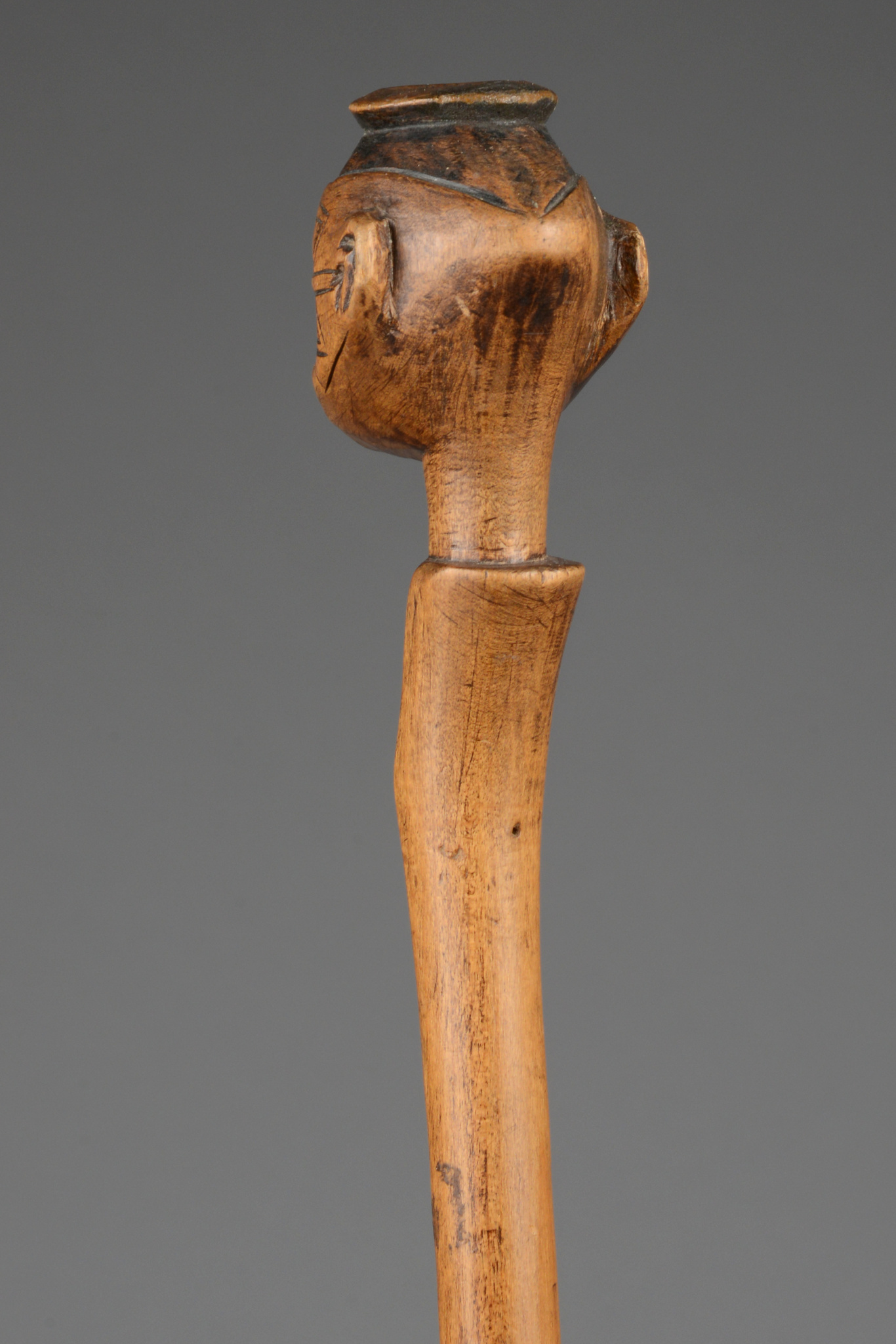 Staff with anthropomorphic head