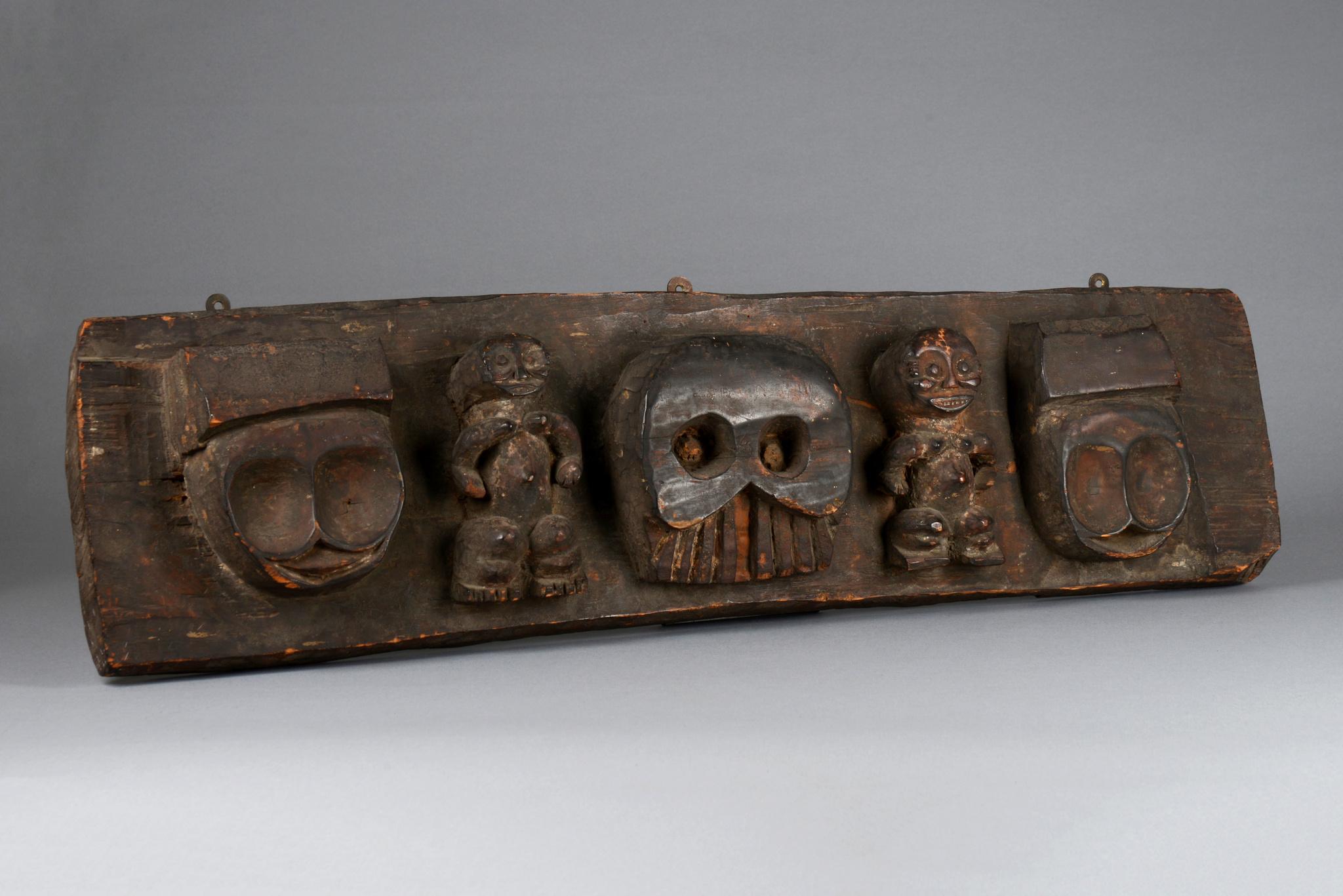 Rare figurally carved ritual board, 19th century