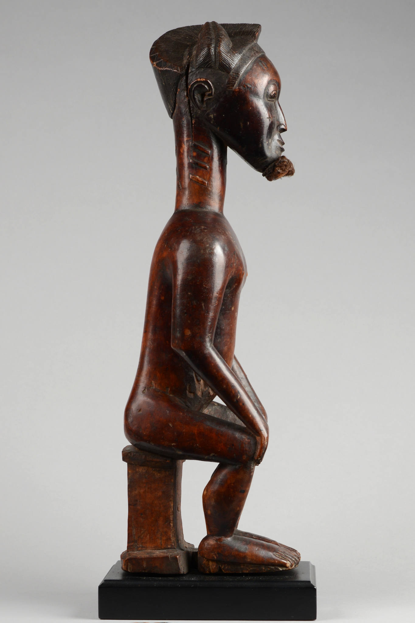 Sitting male figure