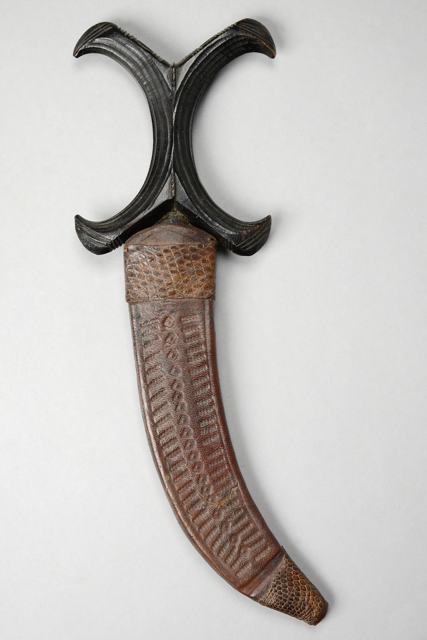 Curved dagger in leather sheath
