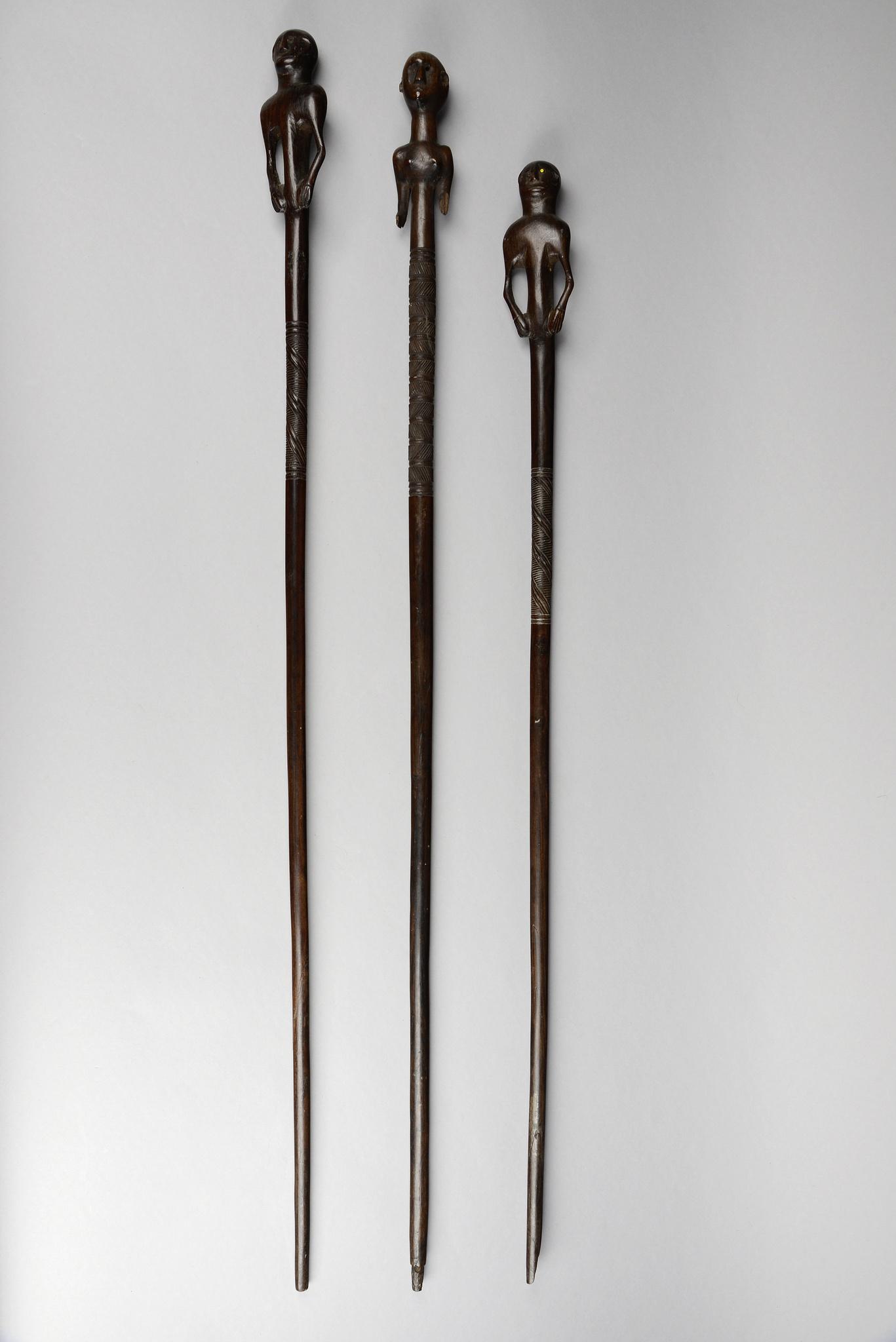 Three figural carved staffs