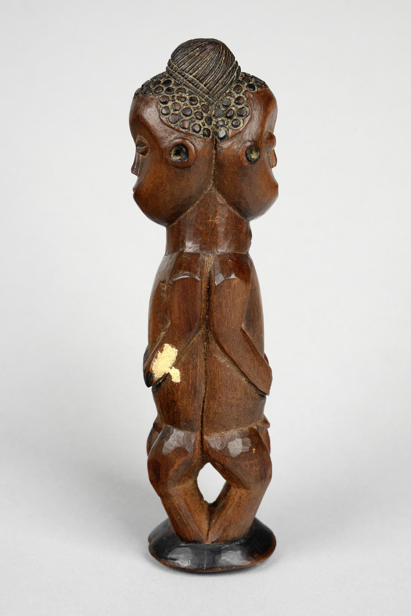Janus figure with prominent coiffure