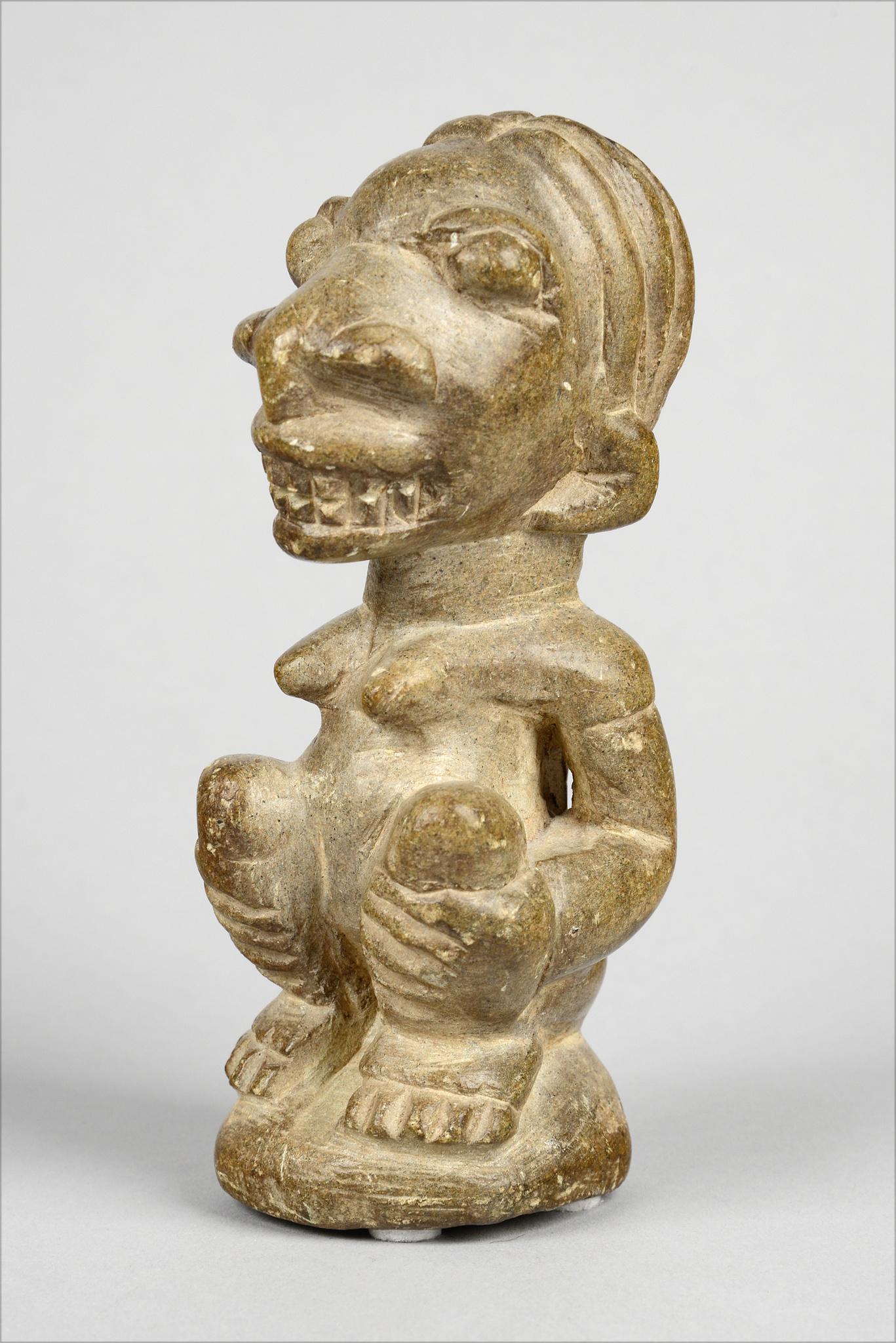 "Squatting female stone figure ""pomdo"" or ""nomoli"""