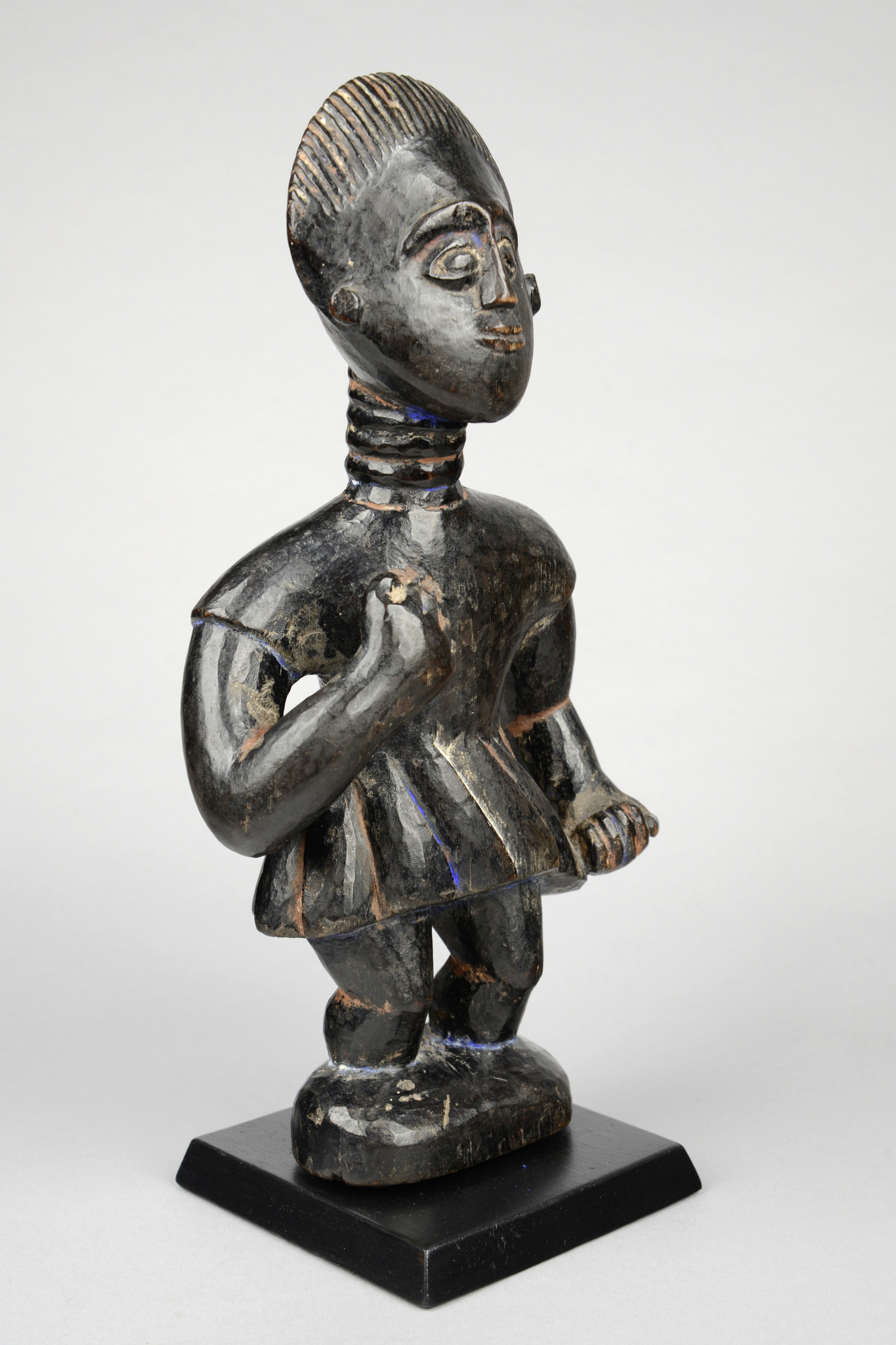 Standing figure with skirt
