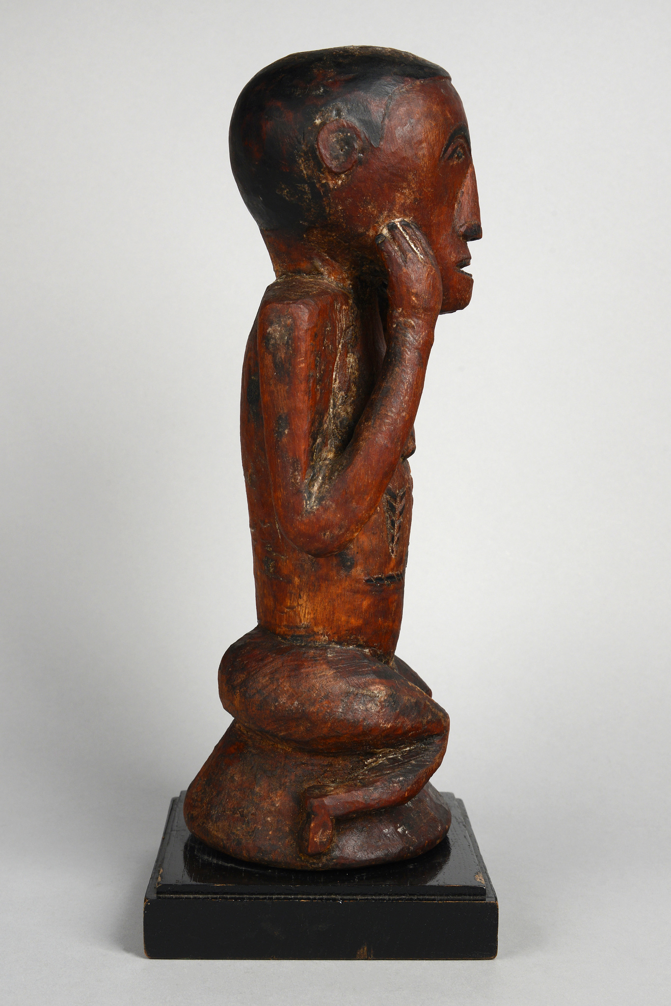 Squatting female figure