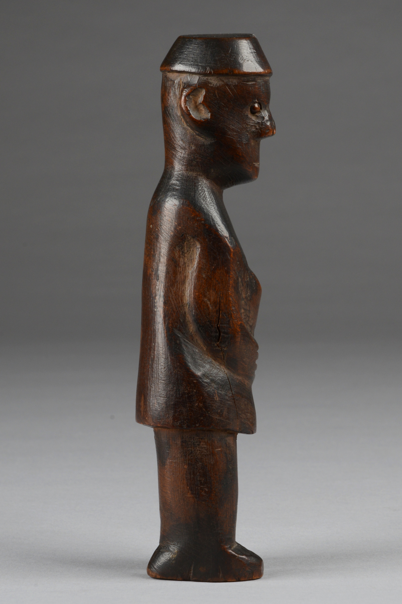 Figure with fez-like headdress