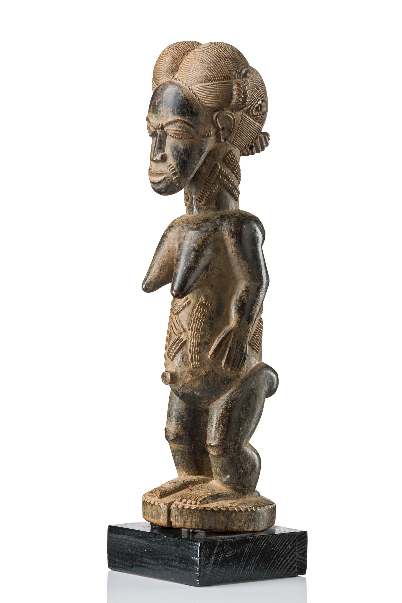 "Standing female figure ""asie usu"" or ""blolo bla"""