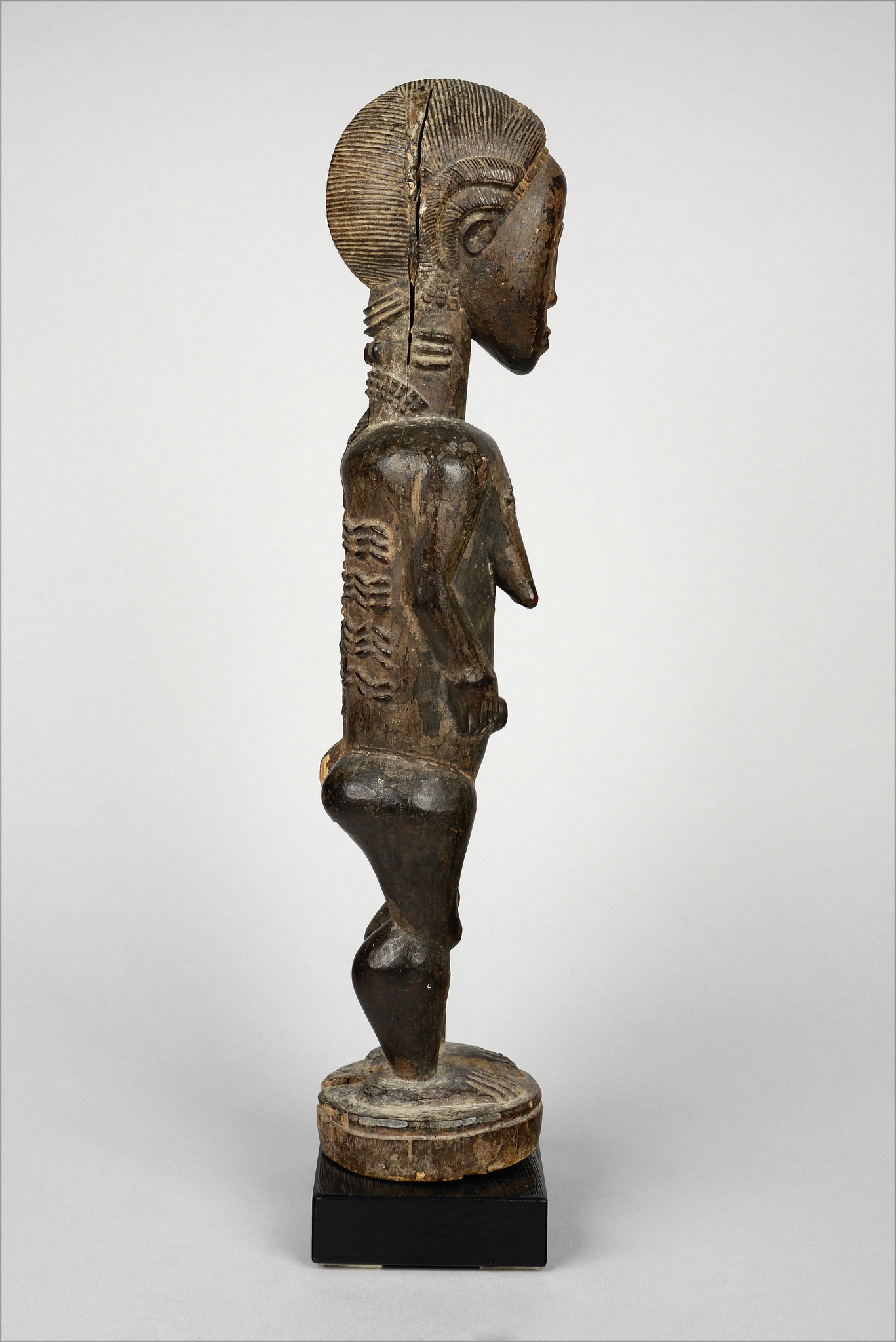 "Standing female figure ""asie usu"" or ""blolo bla"""