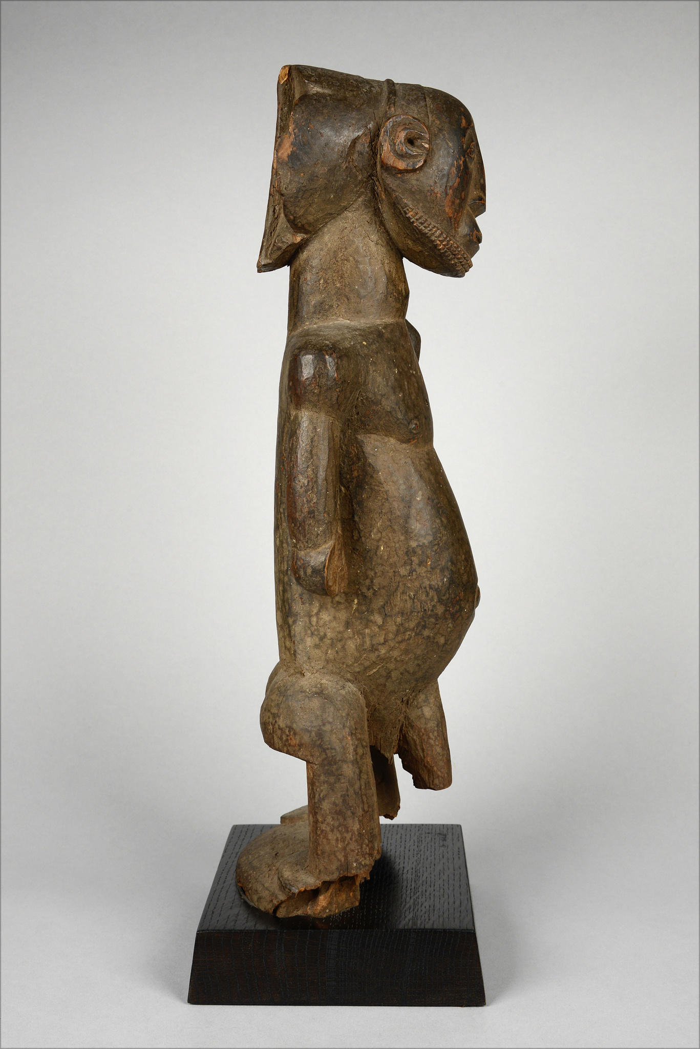 "Standing male ancestor figure ""singiti"" with hoe"