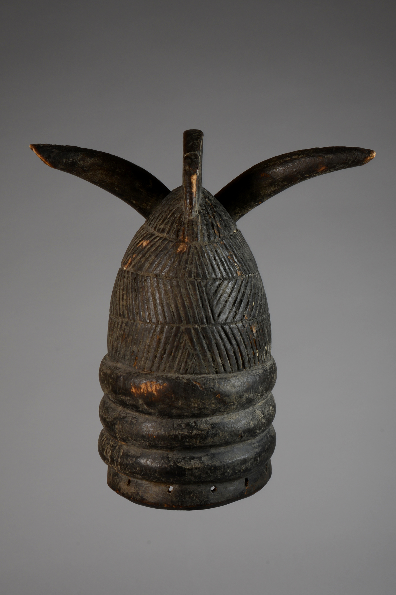 "Helmet mask ""ndoli jowei"" of the ""sande"" (or ""bundu"") society"