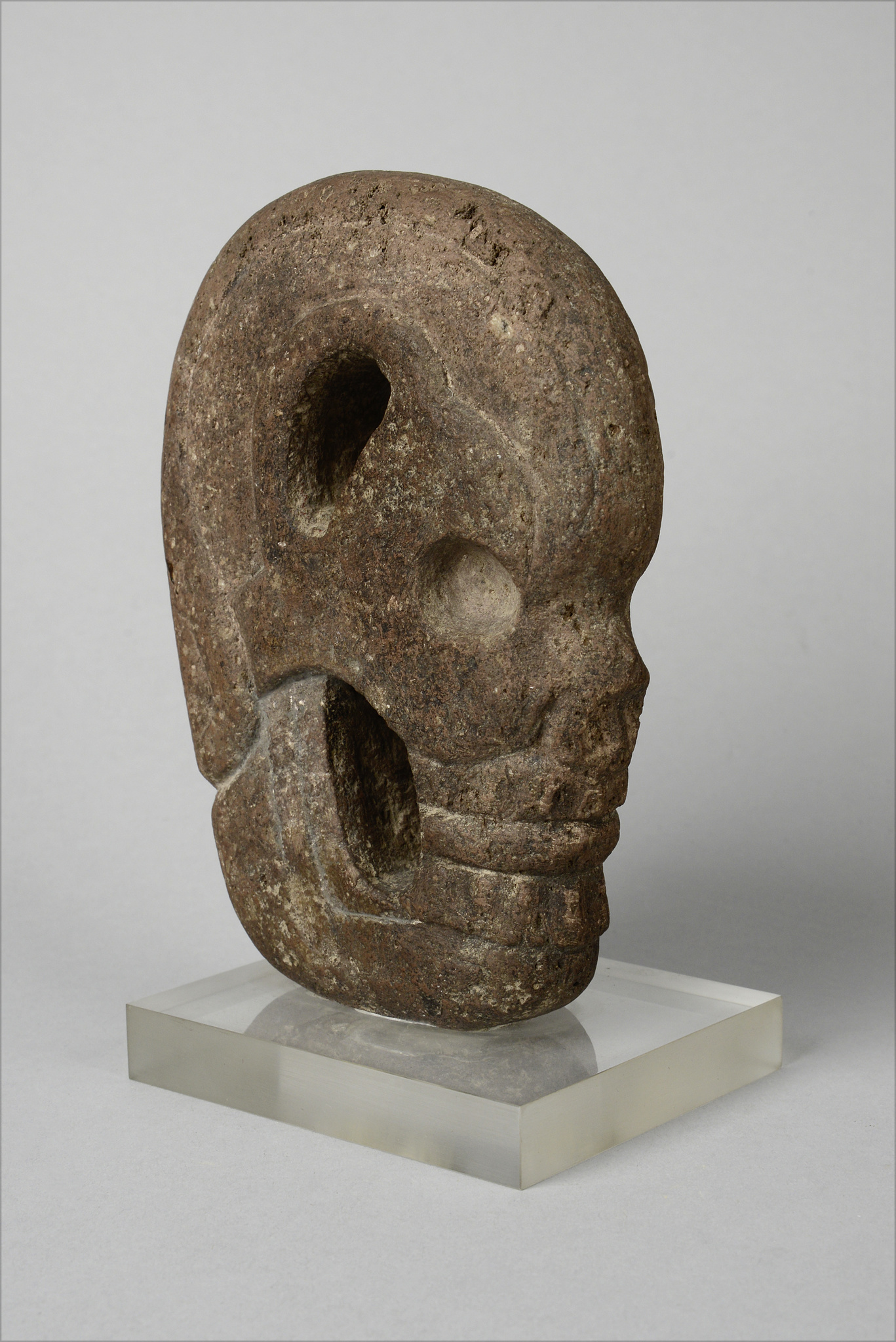 """Hacha"" in shape of a human skull in profile, ca. 500-950 AD"