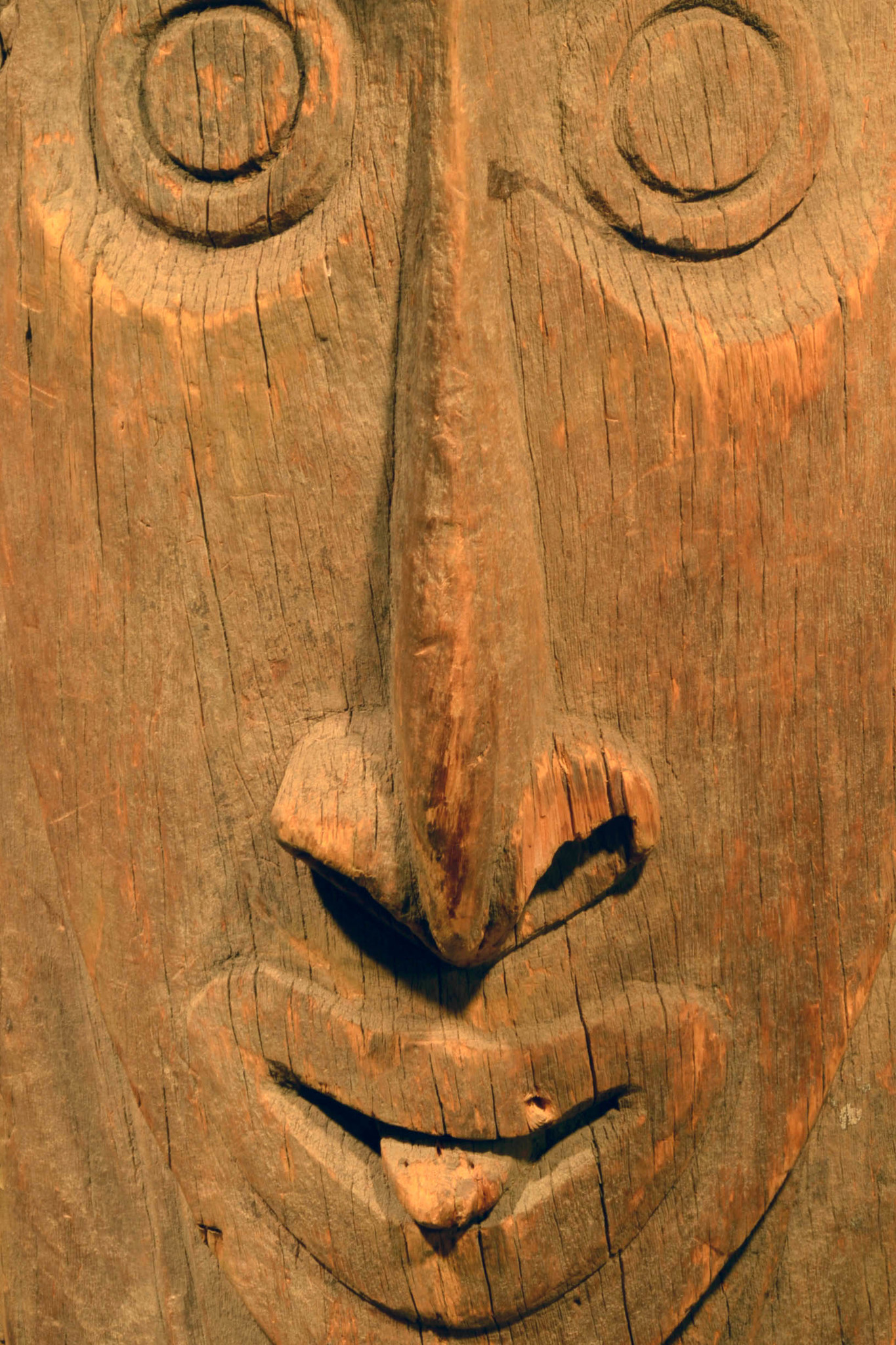House post with stylized ancestor spirit
