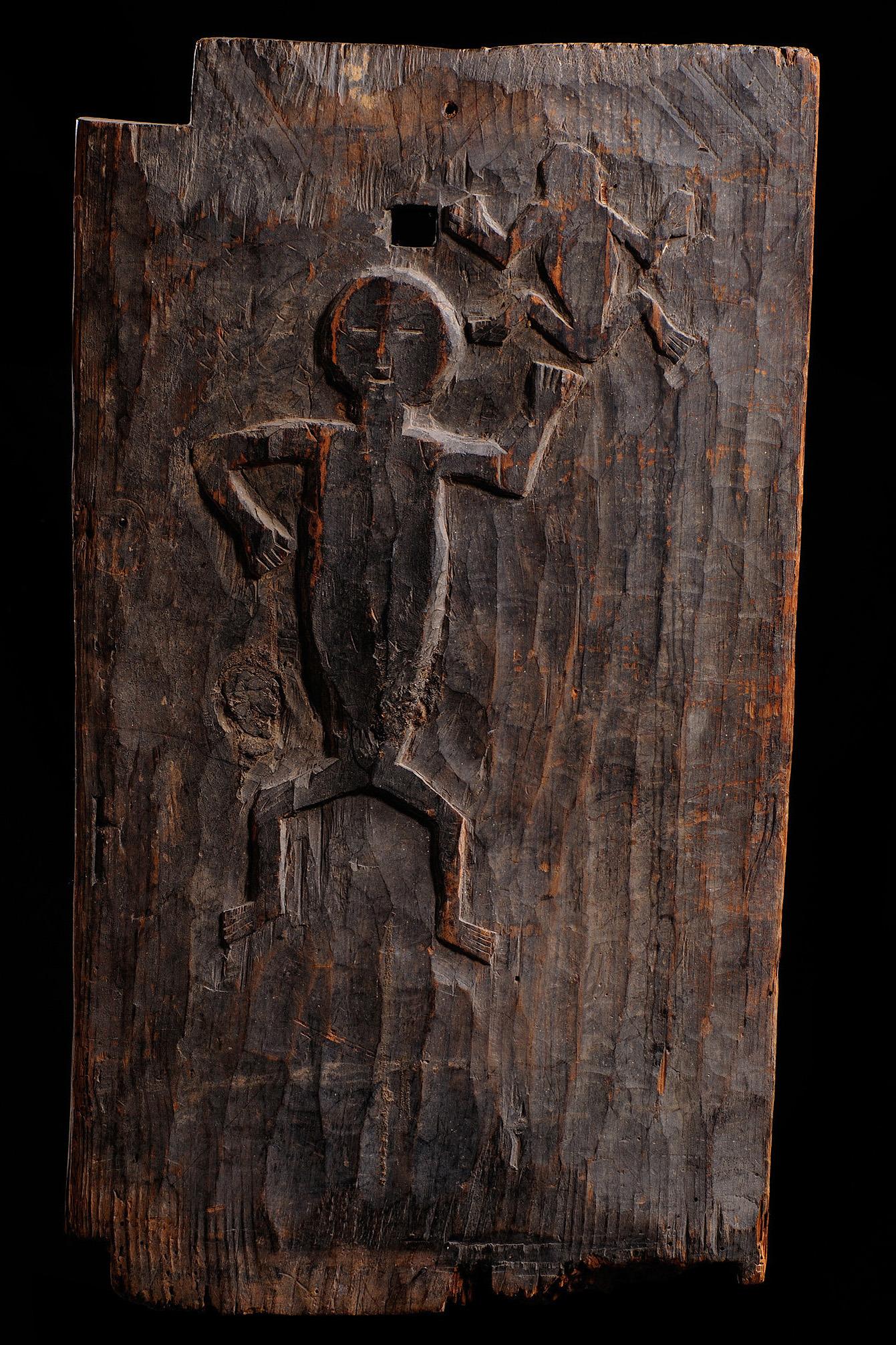 Rice storage door with two figures in bas-relief, 1930