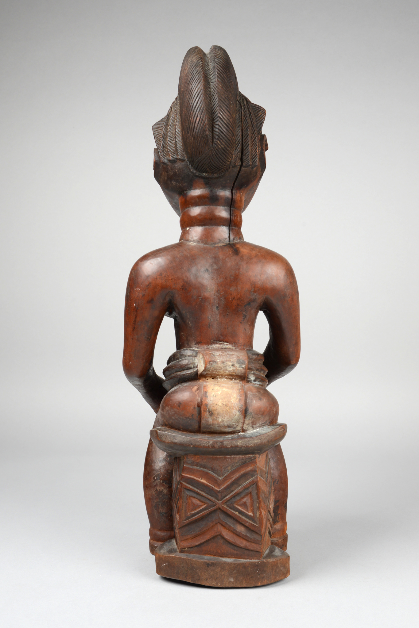 "Seated female figure ""asie usu"""