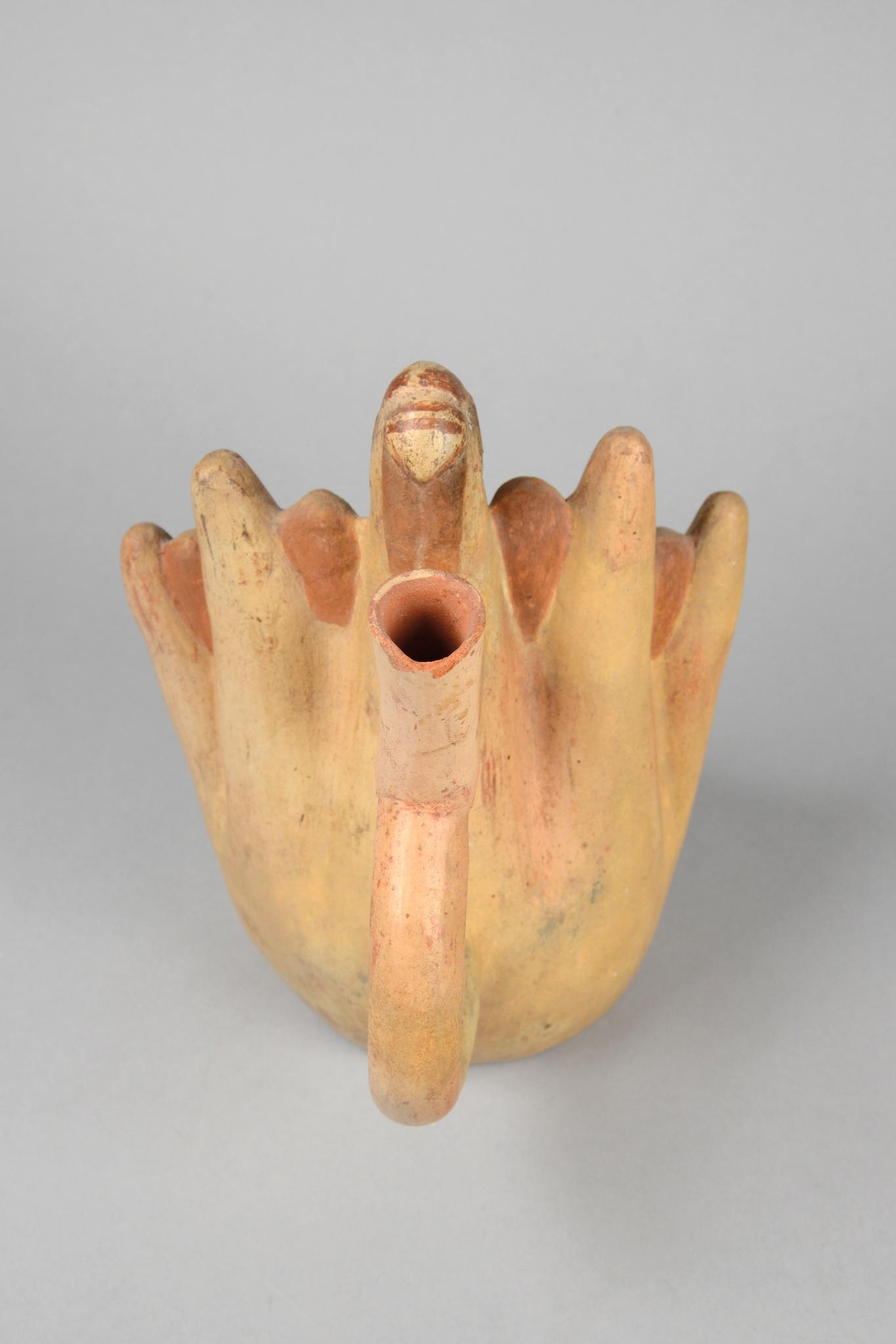 Stirrup-spouted vessel with sacrificial scene