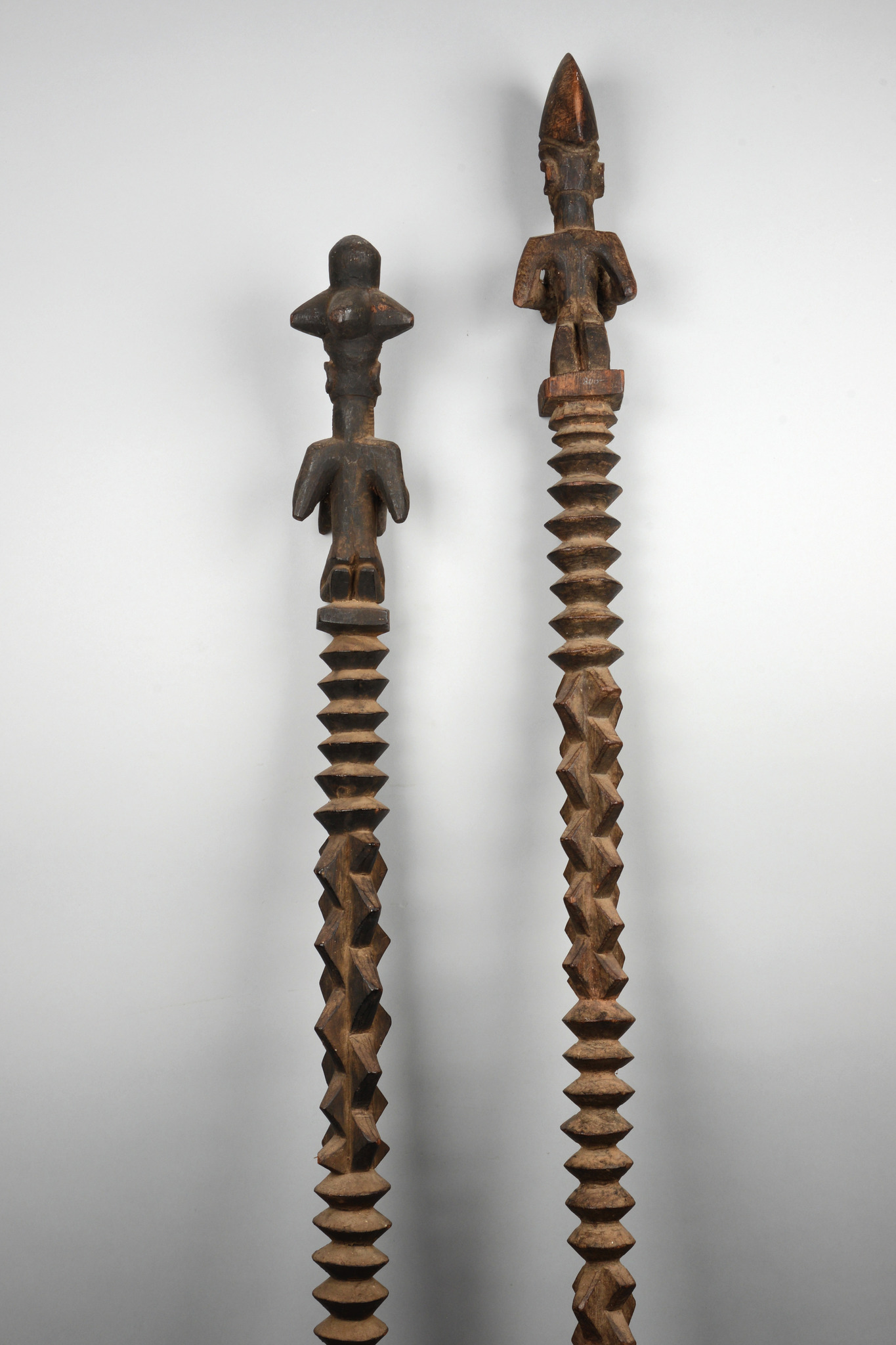 Two figural carved altar staffs