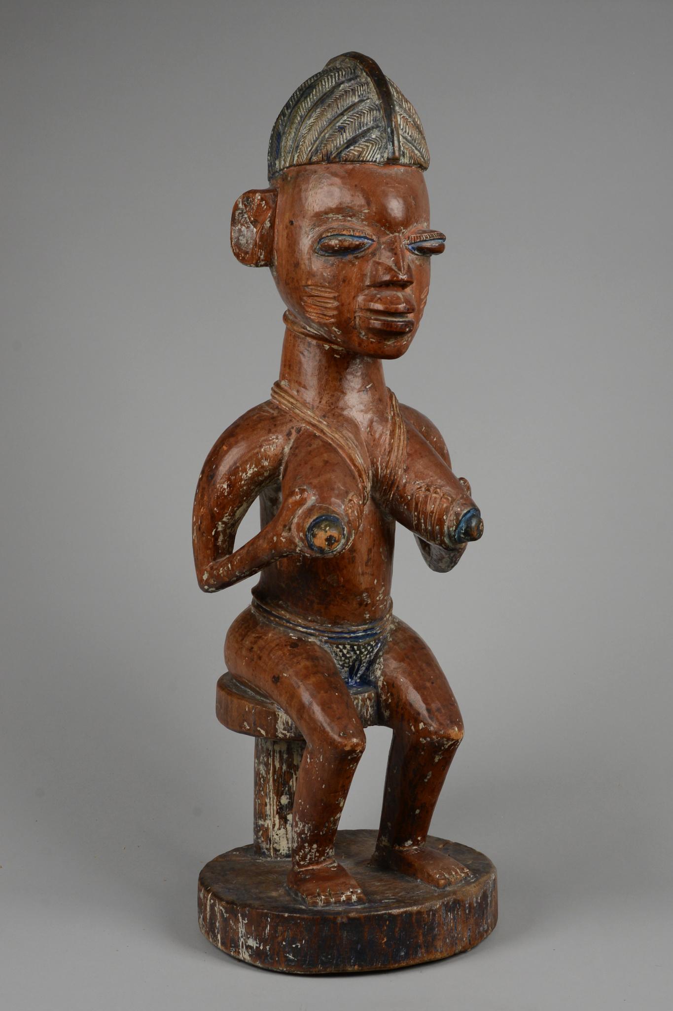 Seated female shrine figure
