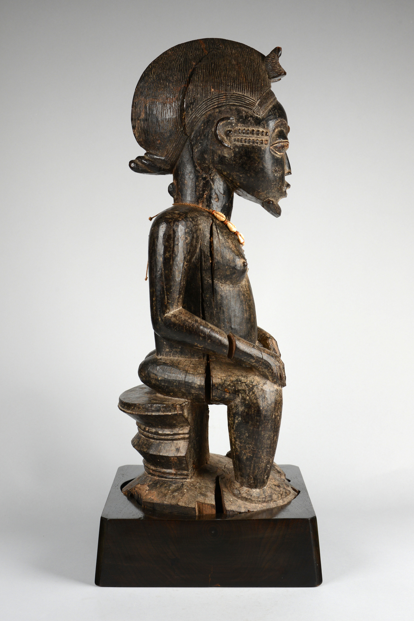 "Seated male figure ""asie usu"""