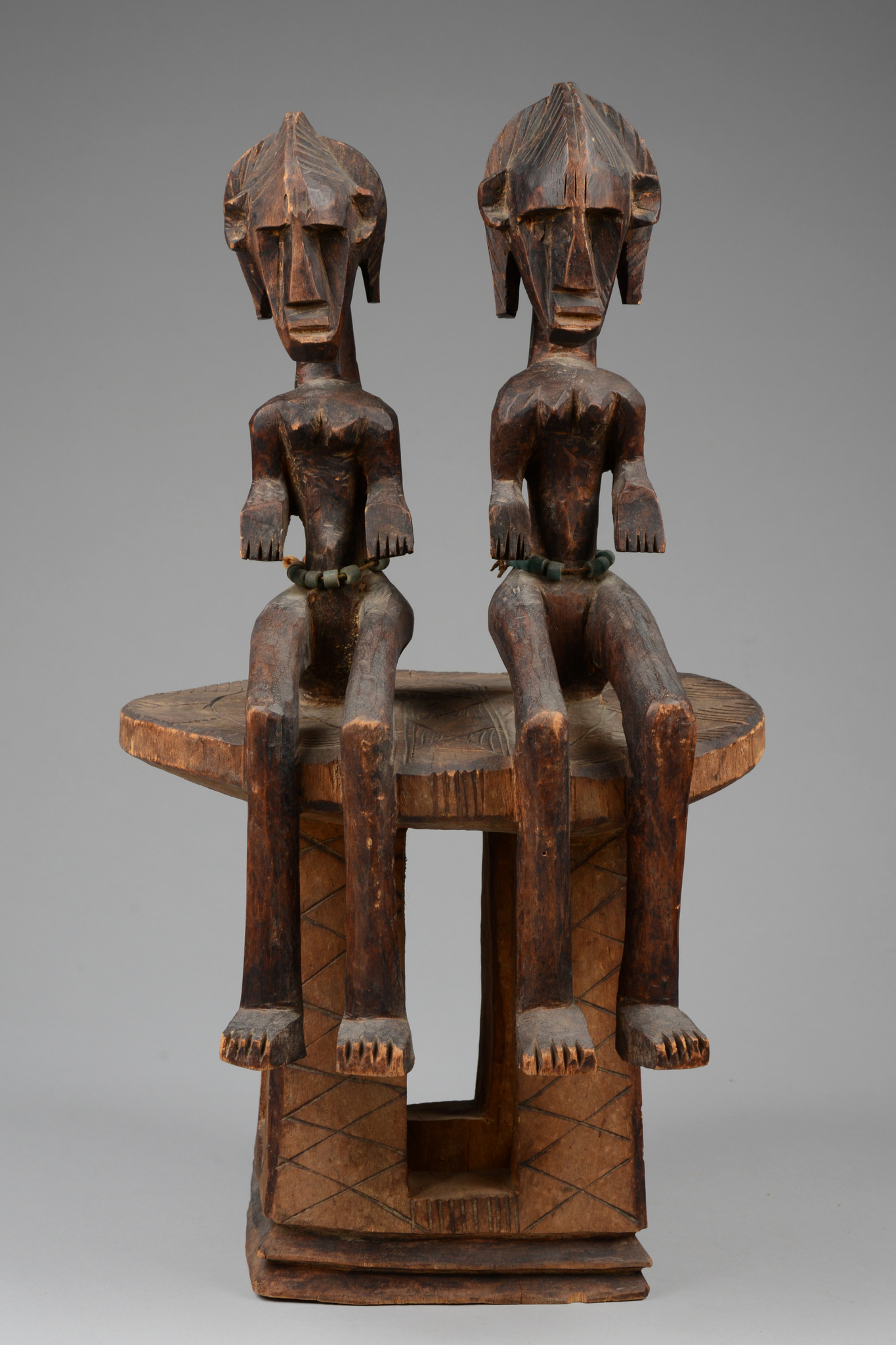Stool with a pair of figures, around 1910/20
