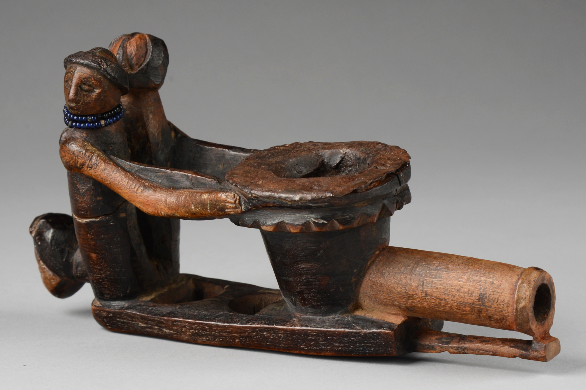 Figurally carved pipe