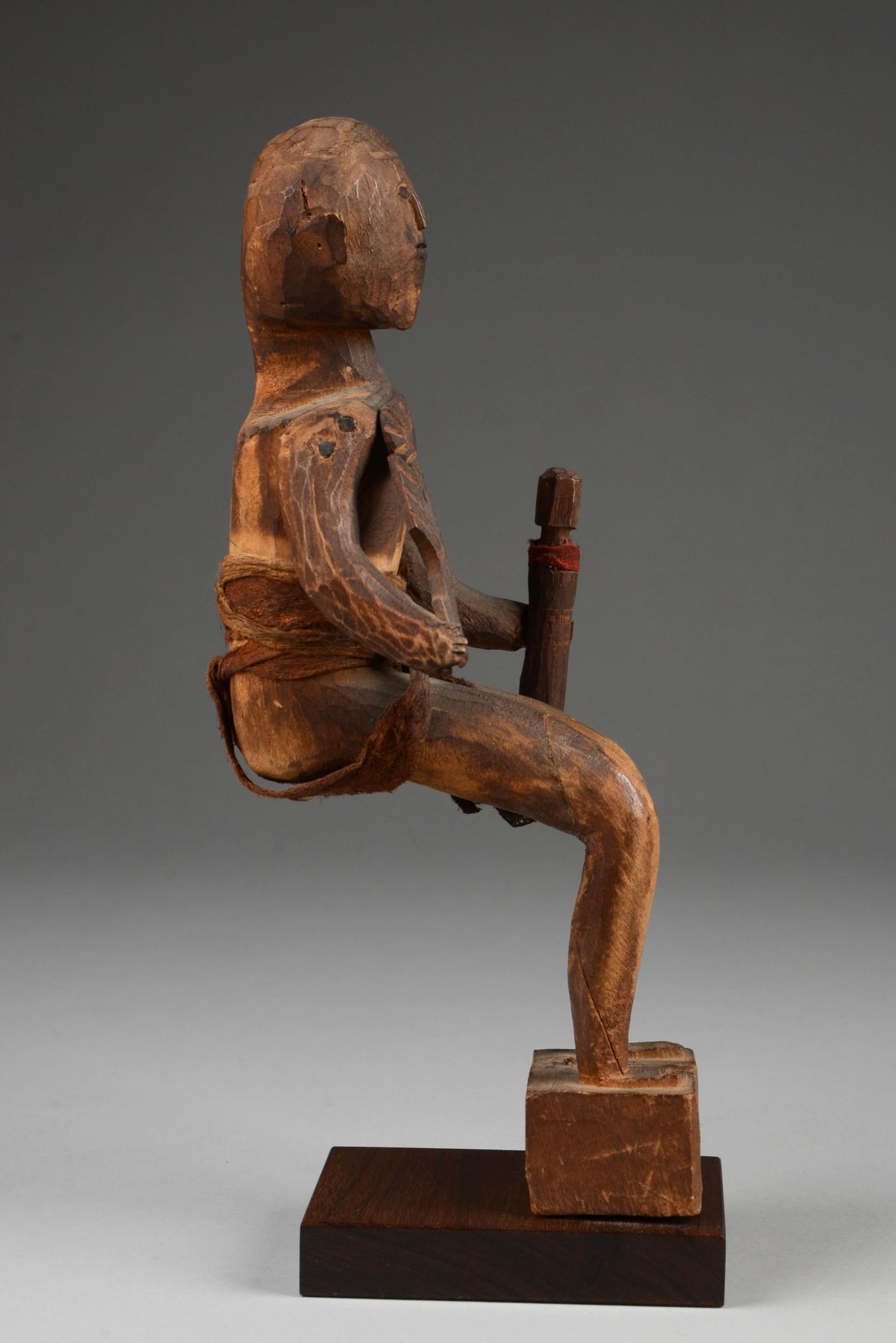 Seated male ancestor figure