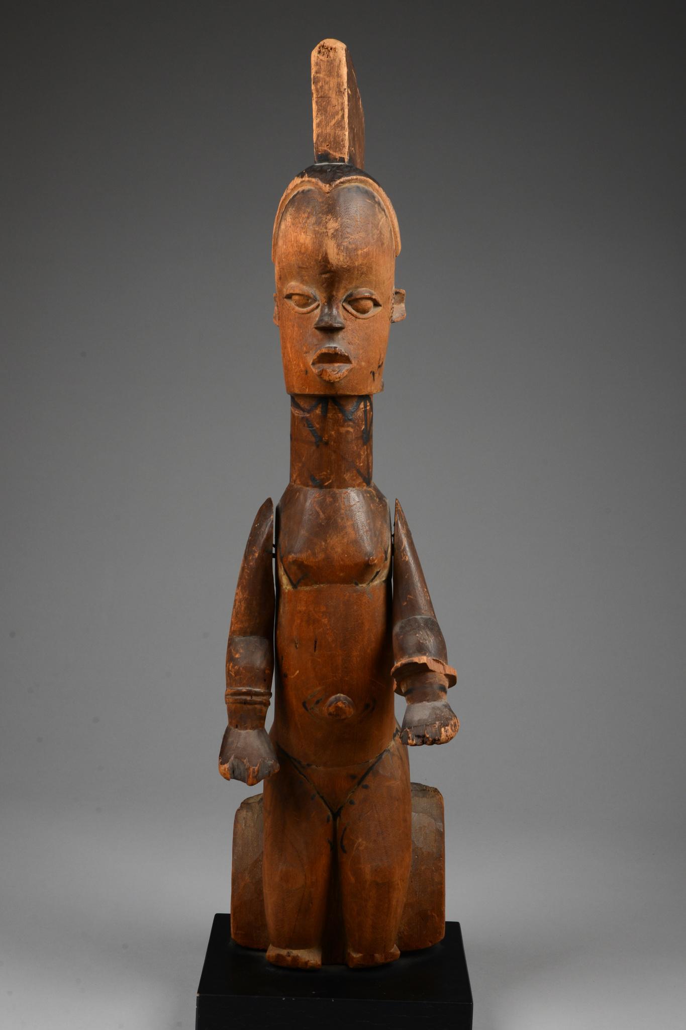 Seated female puppet figure