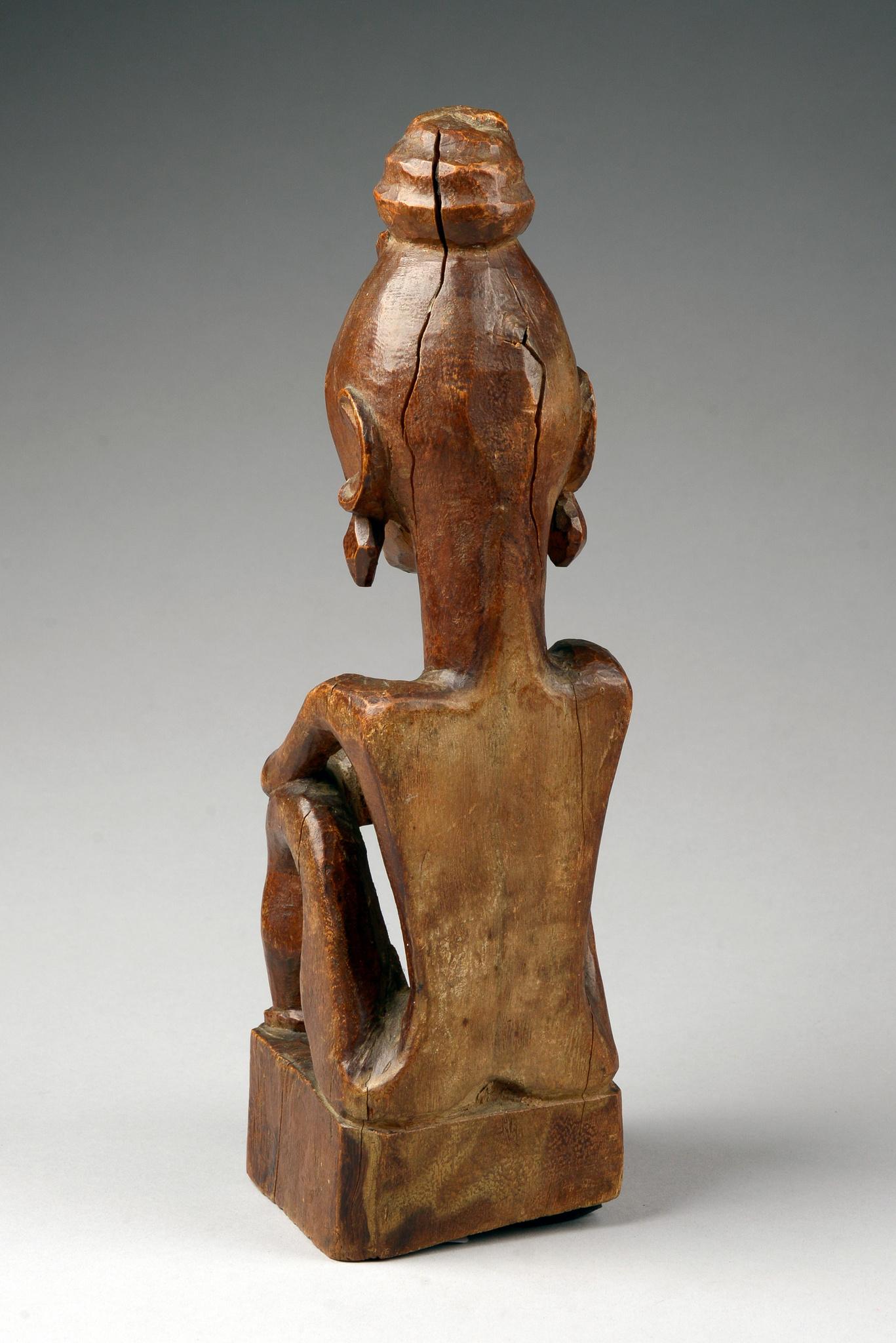 "Squatting female ancestor figure ""iene"" with sacrificial bowl"
